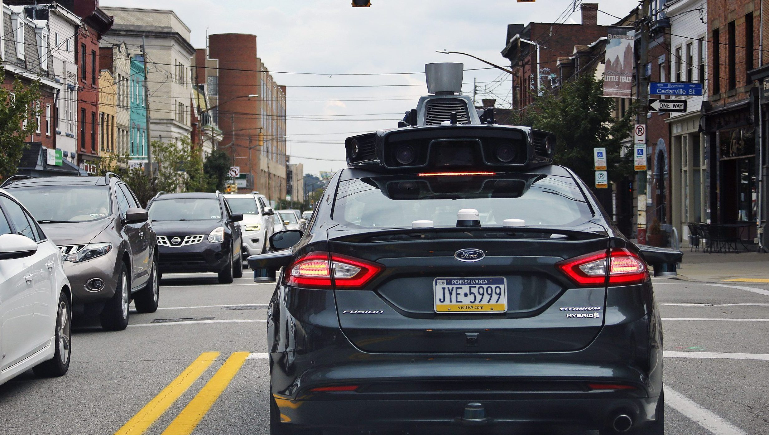 A self driving Uber car drives on Liberty Ave. through the Bloomfield neighborhood of Pittsburgh Wednesday, Sept. 14, 2016. On Wednesday, a fleet of self-driving Ford Fusions began picking up Uber riders who opted to participate in a test program. While the vehicles are loaded with features that allow them to navigate on their own, an Uber engineer sits in the driver's seat and can seize control if things go awry. (AP Photo/Gene J. Puskar)