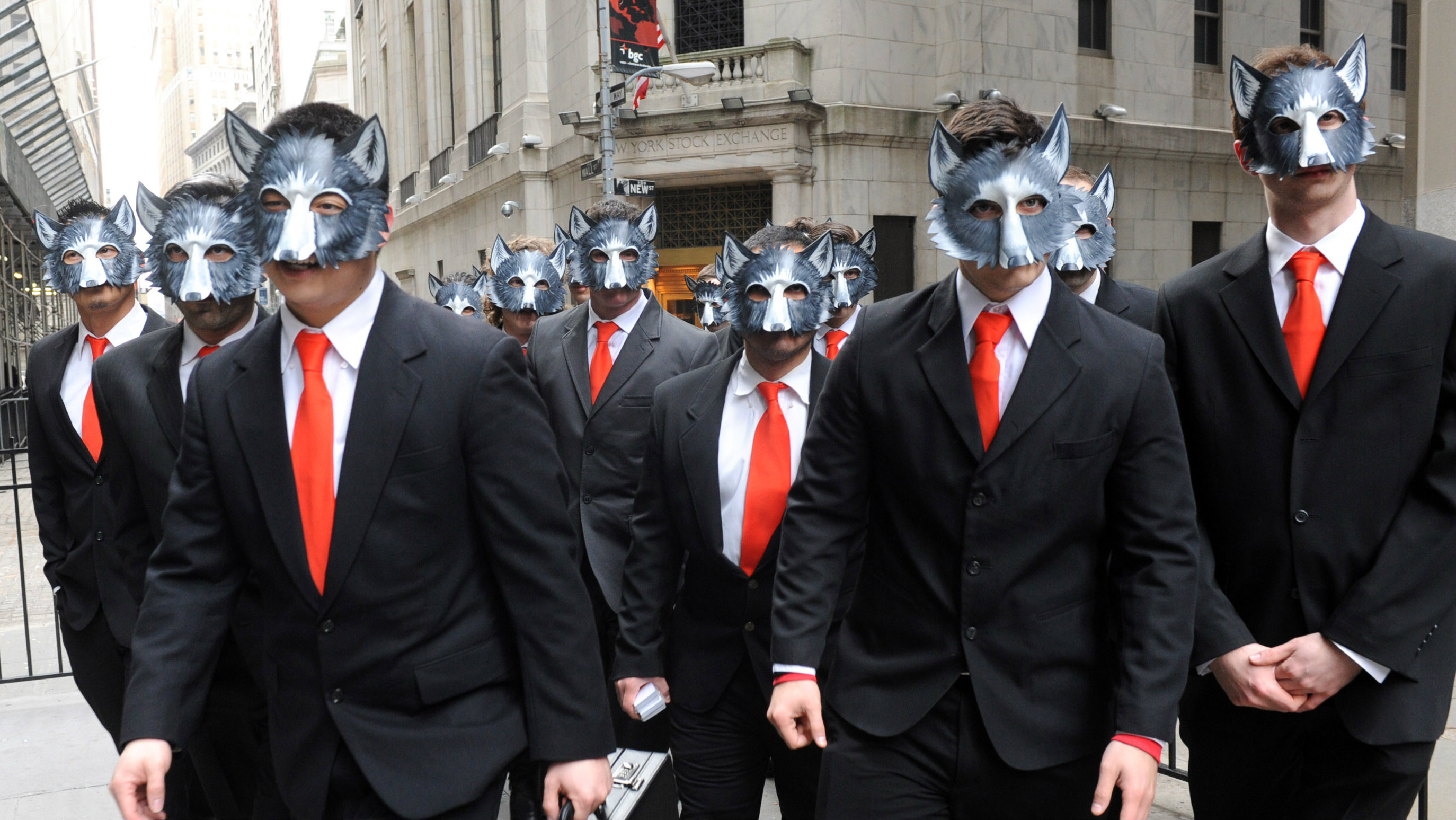 """A pack of """"wolves"""" invade Wall Street, Tuesday, March 25, 2014, in New York, to celebrate the Blu-ray release of the hit movie The Wolf of Wall Street."""