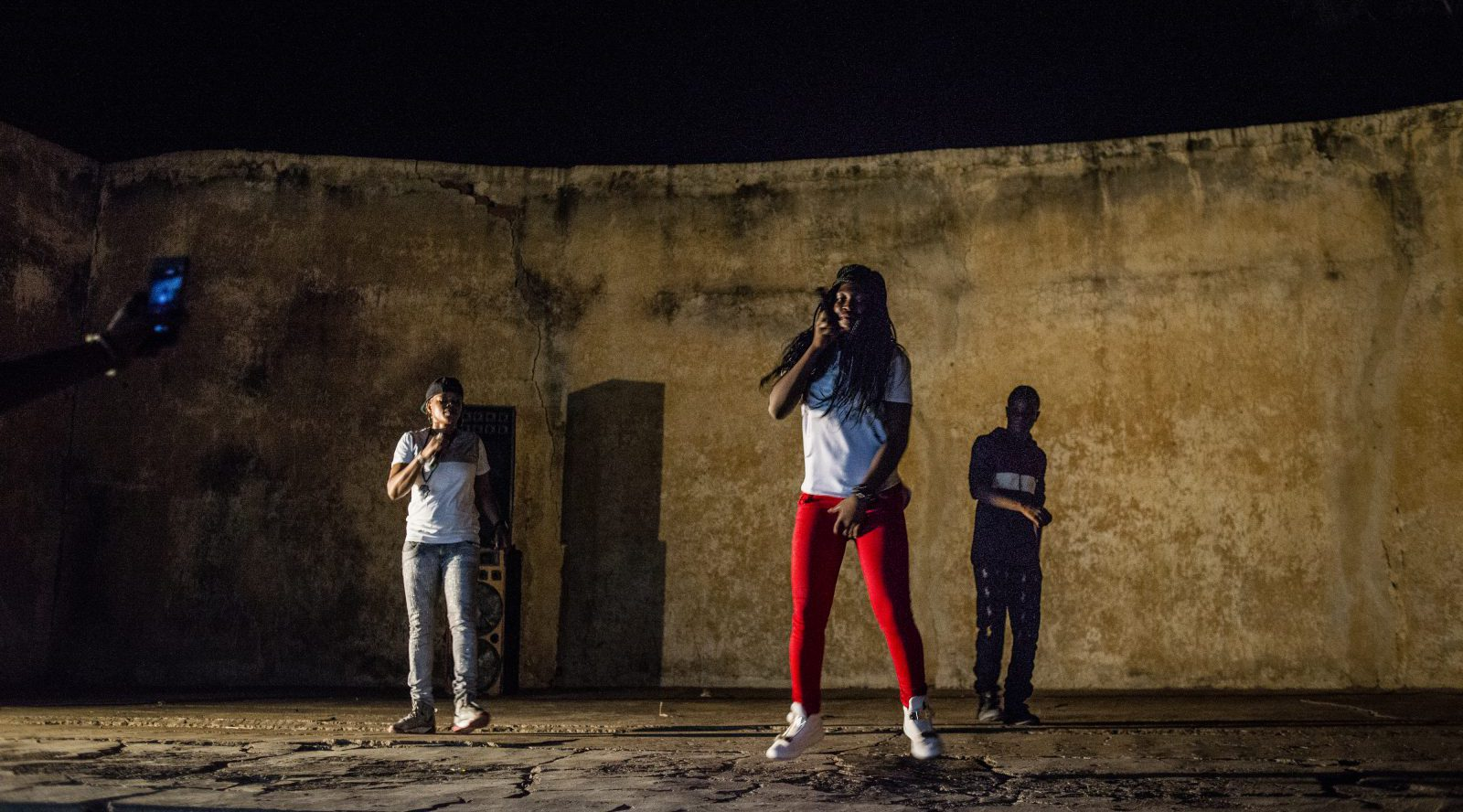 Little Ami (center) takes the stage with Ami (left) during one of her last songs of the evening on May 20, 2017 in Macina, Mali.