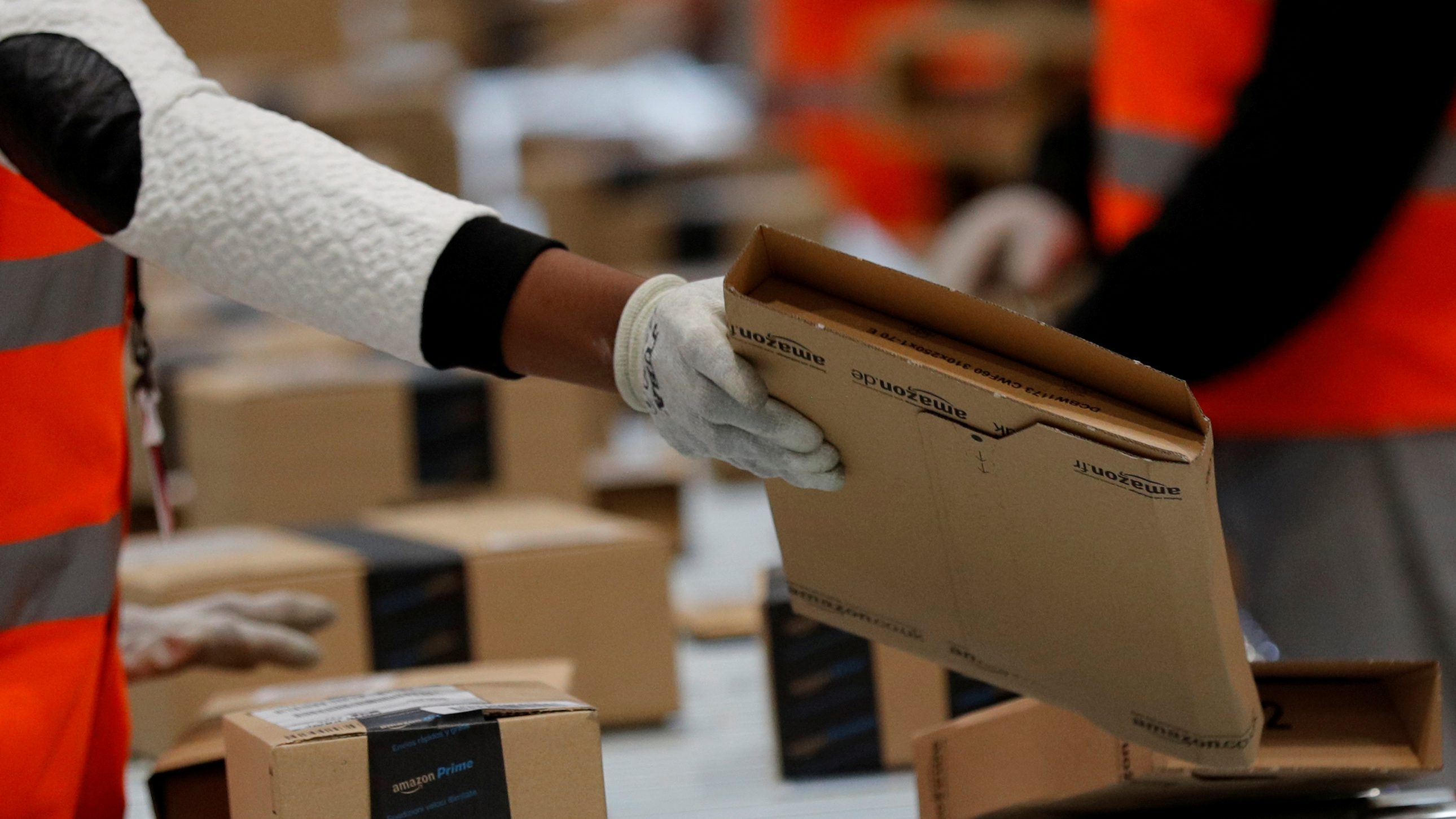 FILE PHOTO: Employees sort packages at the Amazon distribution center warehouse in Saran, near Orleans, France, November 22, 2016. REUTERS/Philippe Wojazer/File Photo - RC1A752F3A30