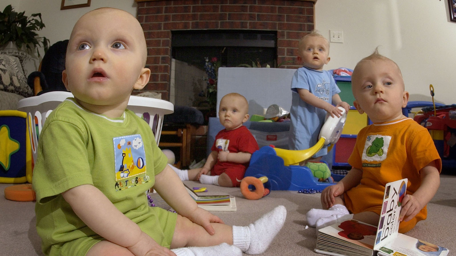 ** ADVANCE FOR APRIL 5-6 ** The Tetrick quadruplets, two sets of identical twins, watch television in their Wichita, Kan. home March 24, 2003. The siblings shown from left; Camden, Christian, Peyton and Parker were born the day before a set of sextuplets were delivered nearly a year ago in Wichita.  (AP Photo/Charlie Riedel)