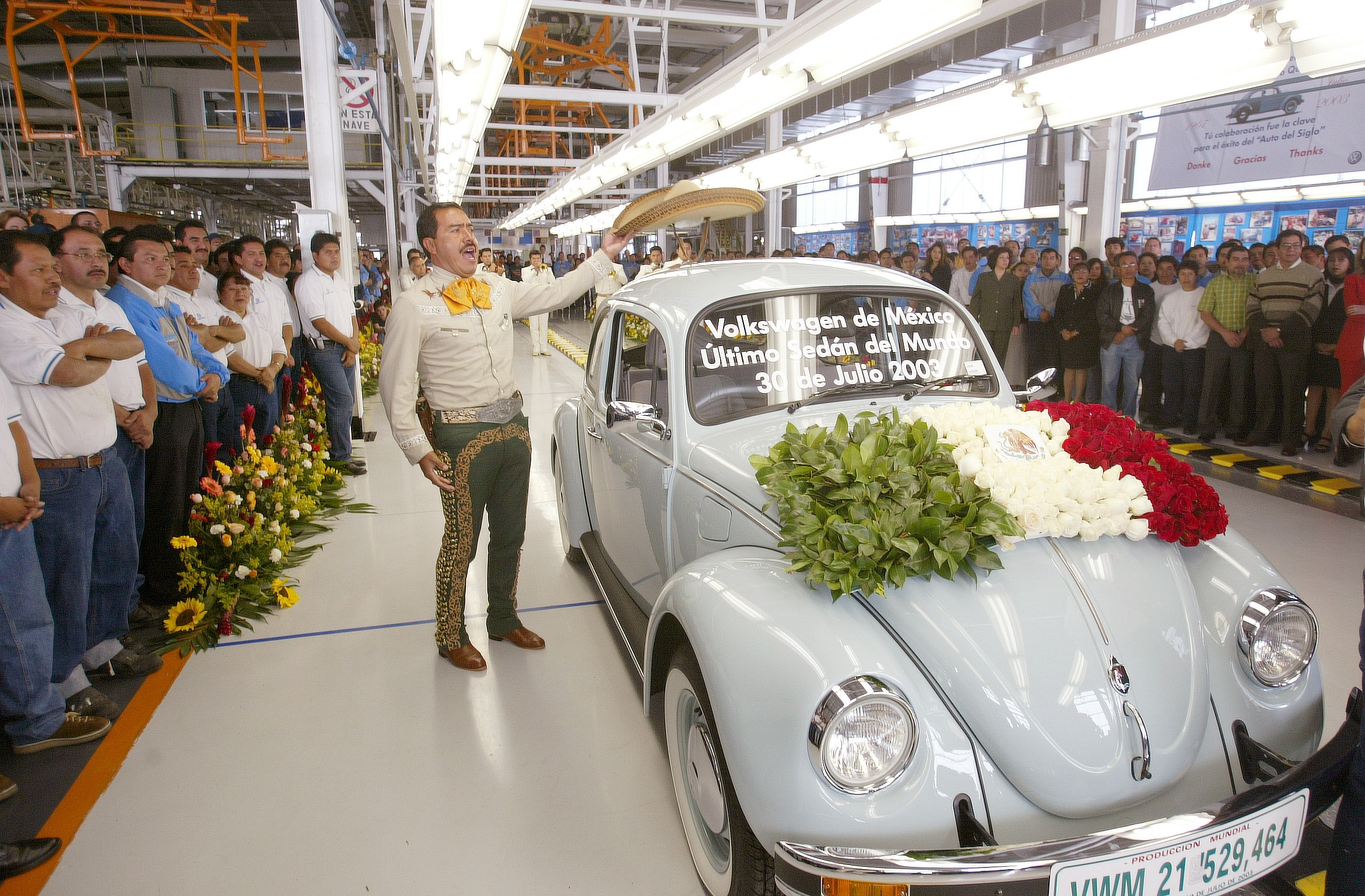 A traditional Mexican Mariachi musician places his sombrero on the roof of the very last VW beetle as it rolls off the production line at VW's Puebla plant Wednesday, July 30, 2003. The car will be sent to a museum in Wolfsburg, Germany. The 300 employees working on the bug assembly line will be reassigned to other departments at the factory, which also produces Jettas and the modern new Beetle.  (AP Photos/Andrew Winning, pool)