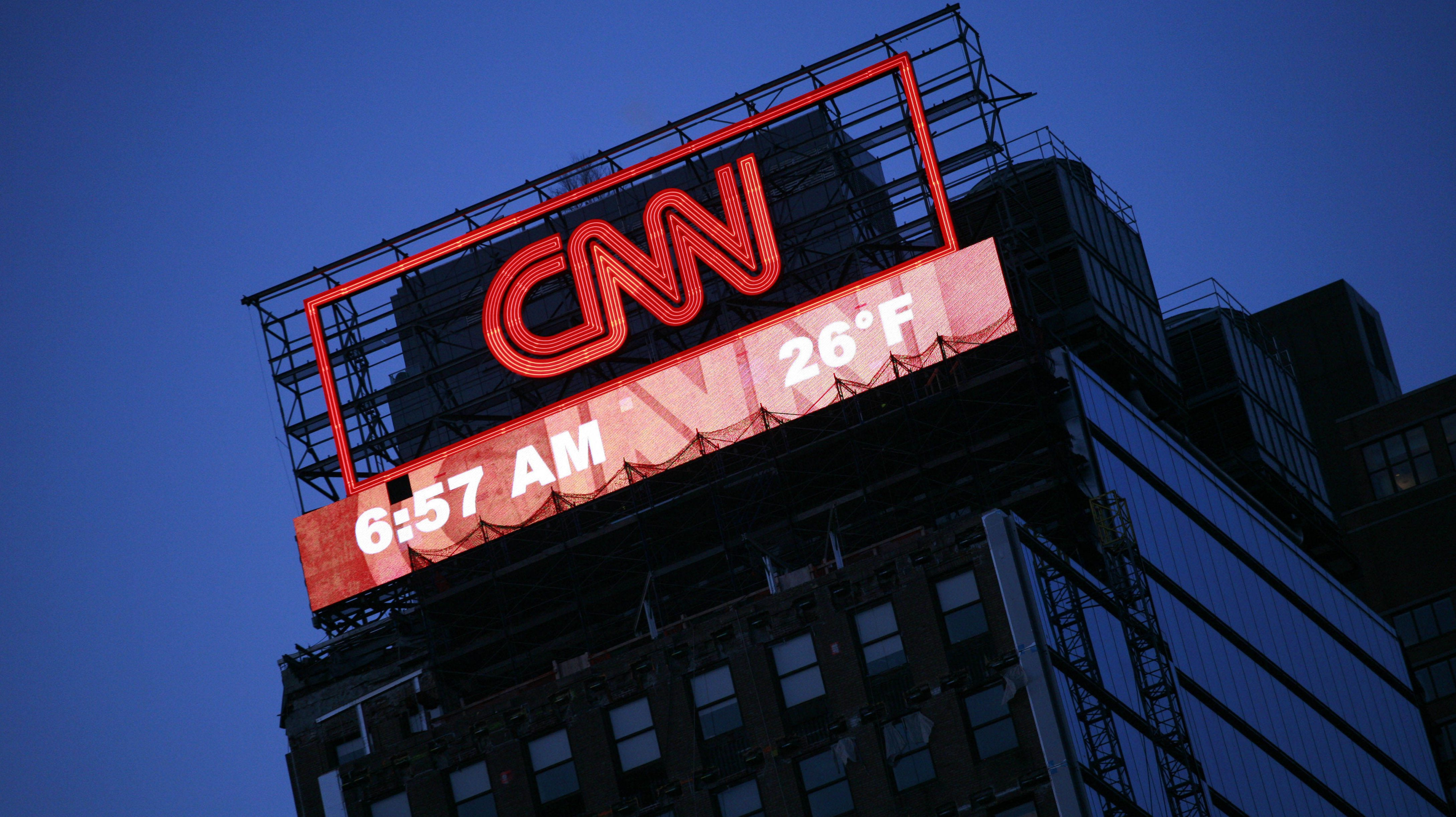 A billboard for CNN is shown Monday, Feb. 1, 2010 in New York. Time Warner, which owns CNN, says it reversed its losses in the fourth quarter, as its cable channels and movie studio boosted revenue. (AP Photo/Mark Lennihan)