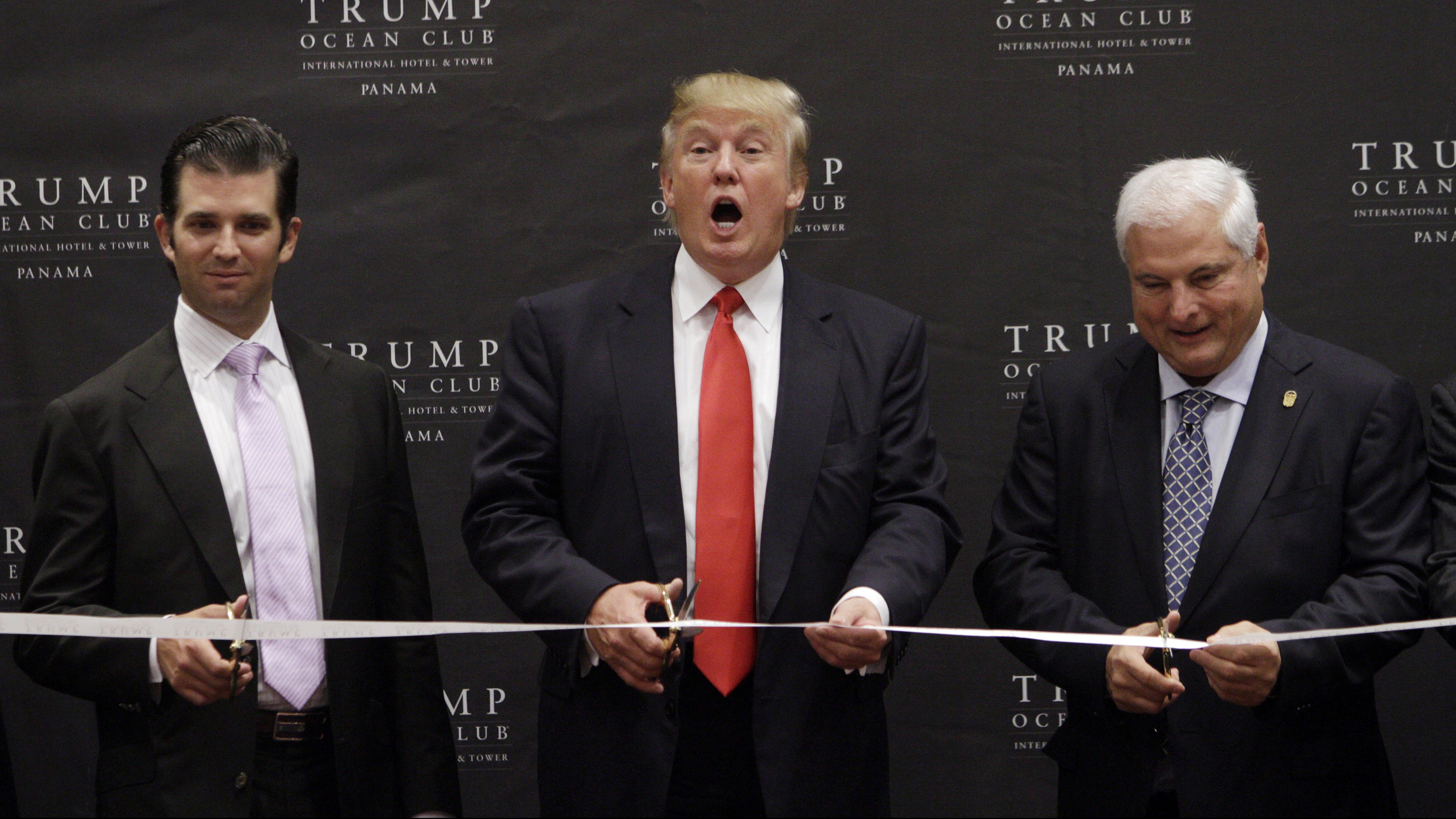 U.S. tycoon Donald Trump, center, his son Donald Trump Jr., left, and Panama's President Ricardo Martinelli cut the ribbon at the inauguration ceremony of the Trump Ocean Club International Hotel and Tower in Panama City, Wednesday July 6, 2011. According to the organizer, the 70-story luxury resort is the tallest building in Latin America. (AP Photo/Arnulfo Franco)