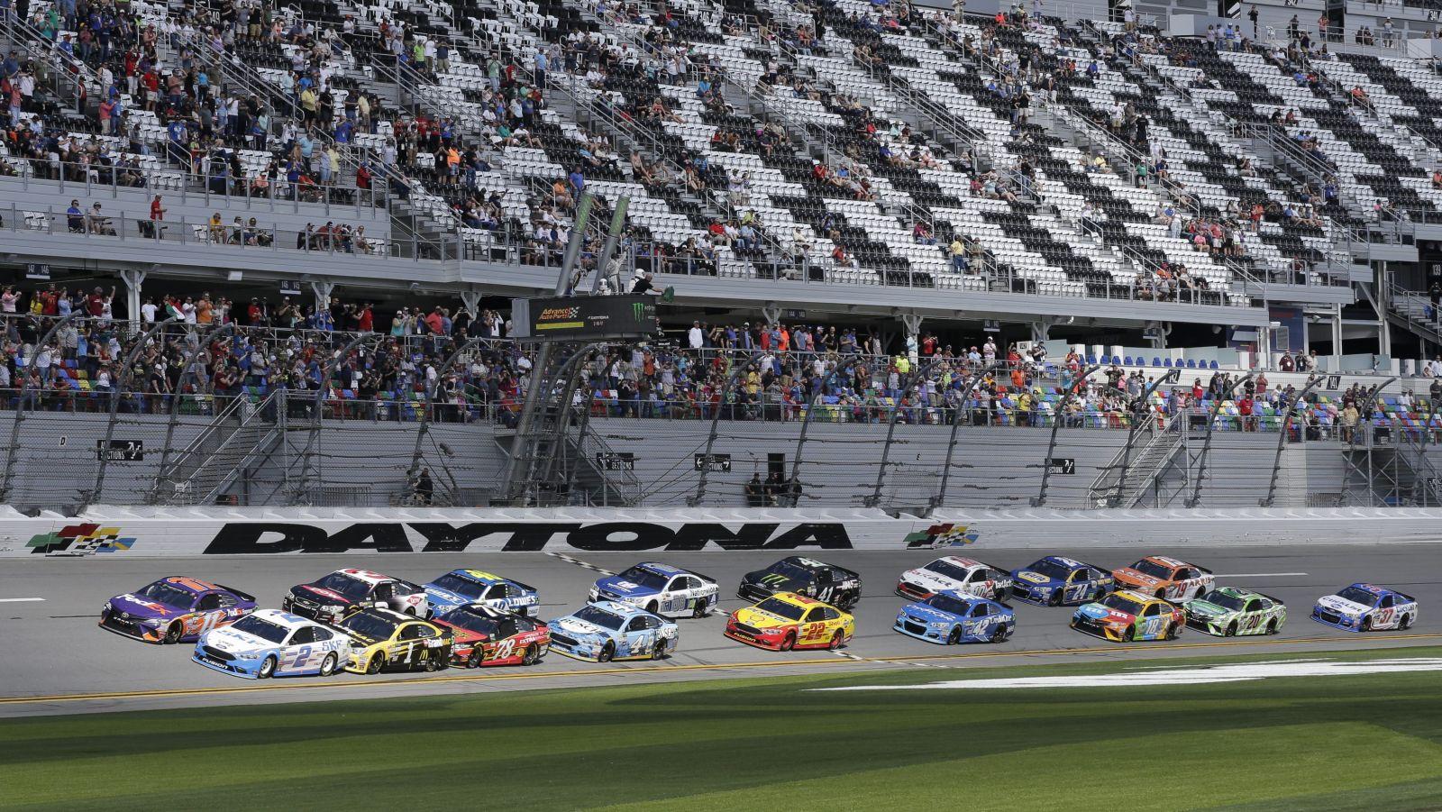 Brad Keselowski (2) and Denny Hamlin, front left, lead the field for the start of the NASCAR Clash auto race at Daytona International Speedway, Sunday, Feb. 19, 2017, in Daytona Beach, Fla. (AP Photo/Terry Renna)