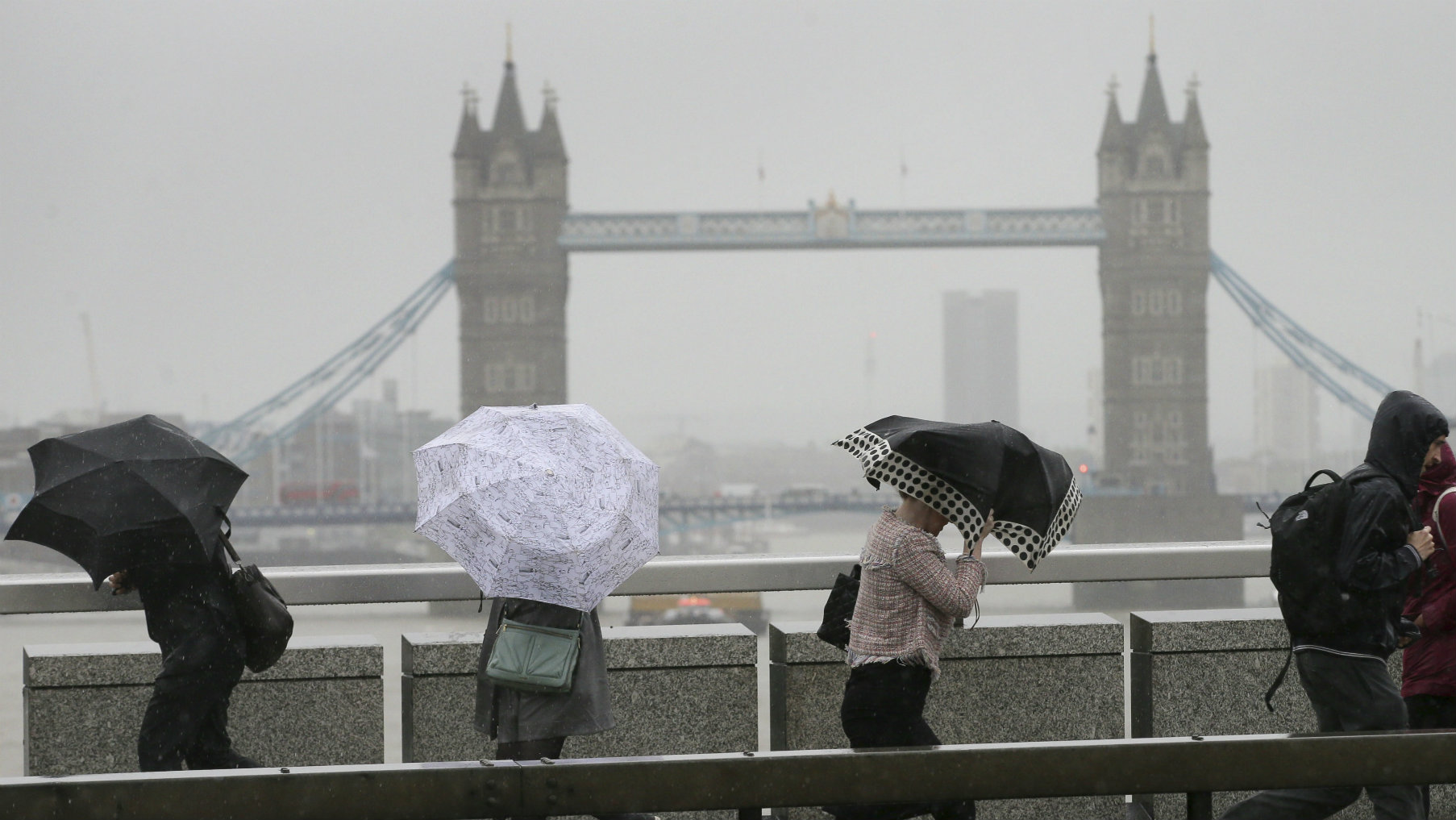 London commuters in the rain