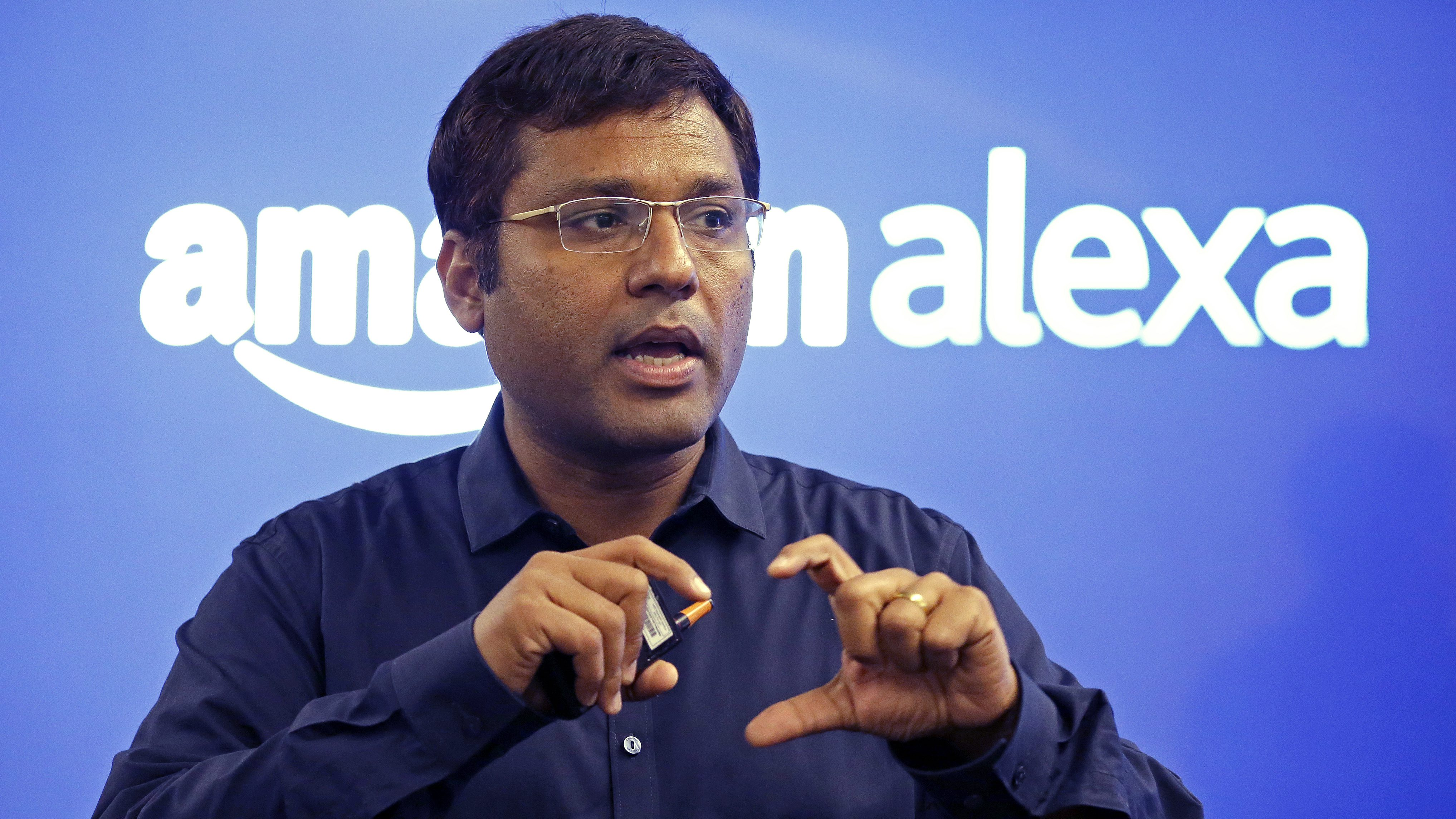 "Rohit Prasad, the Amazon scientist in charge of developing the artificial- intelligence software's abilities to grasp human language, speaks to journalists following a program announcing several new Amazon products by the company, Wednesday, Sept. 27, 2017, in Seattle. Amazon says it is cutting the price of its Echo smart speaker to $100 from $180, improving the sound quality and upgrading its appearance with six new ""shells."" The next generation speaker, which is powered by Amazon's Alexa voice assistant, will have a dedicated woofer and a tweeter for the first time, as well as Dolby sound. (AP Photo/Elaine Thompson)"