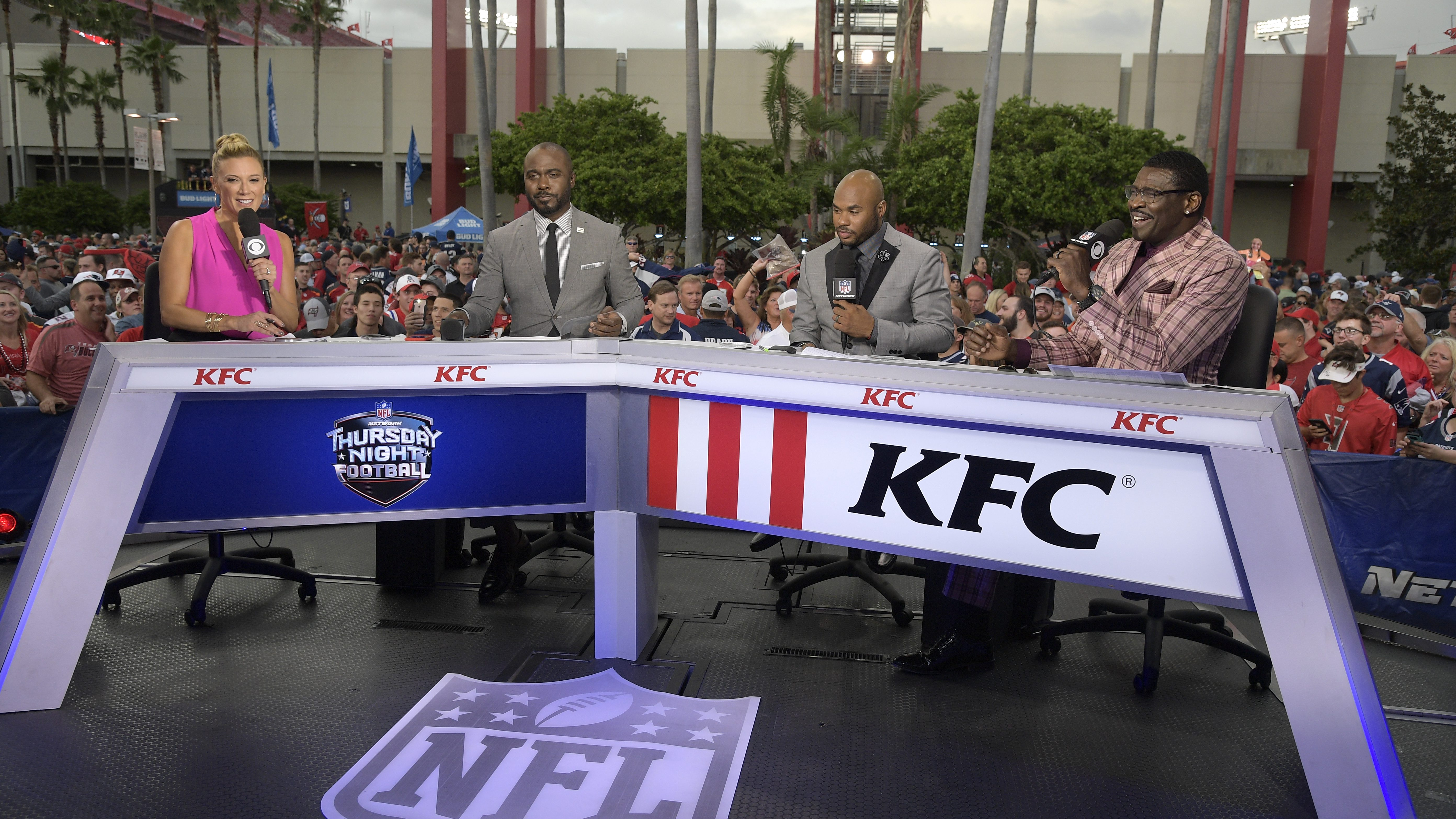 Thursday Night Football talent broadcast from a mobile set outside Raymond James Stadium before an NFL football game between the Tampa Bay Buccaneers and the New England Patriots Thursday, Oct. 5, 2017, in Tampa, Fla. (AP Photo/Phelan M. Ebenhack)