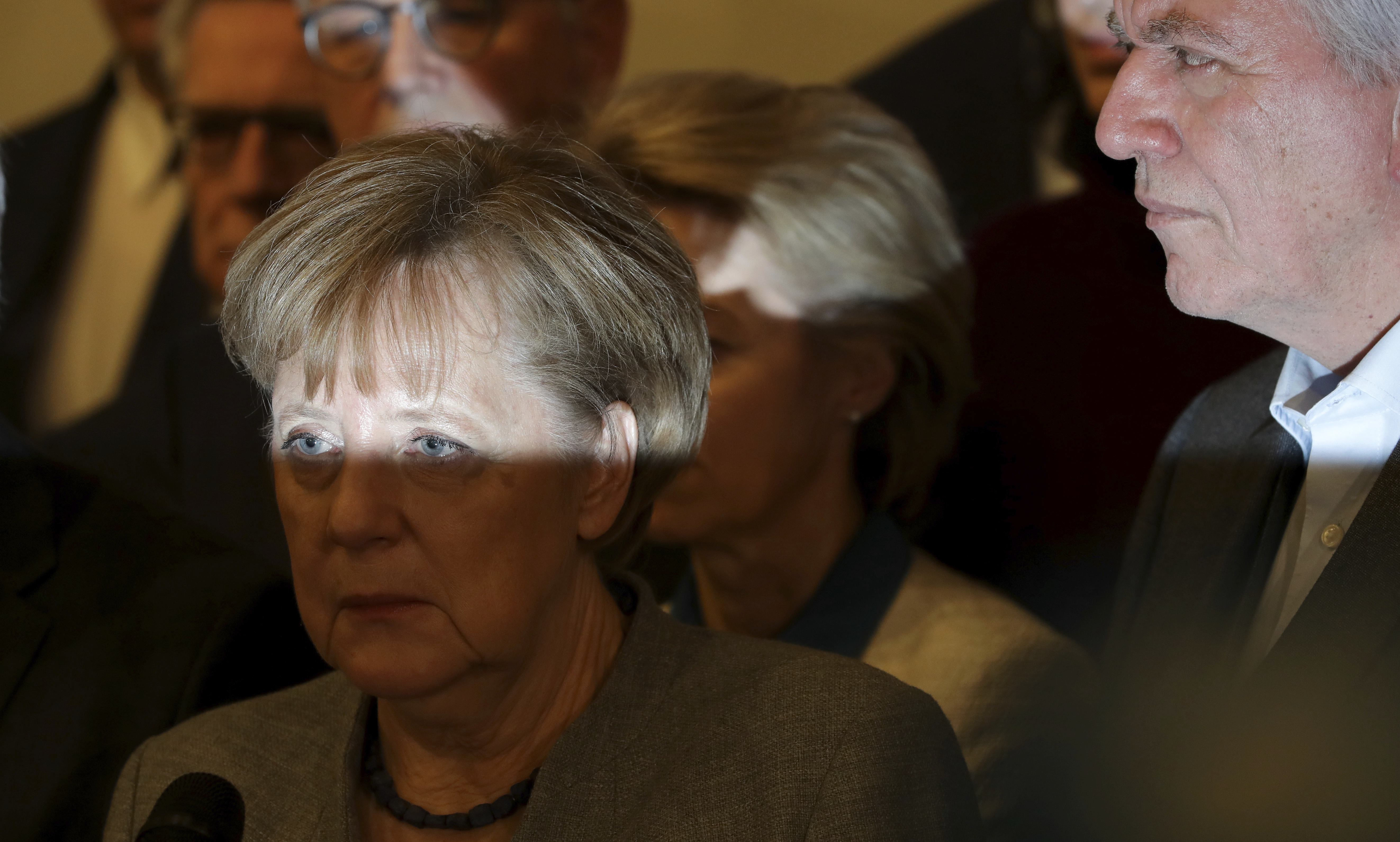 German Chancellor and chairwomen of the German Christian Democratic Union (CDU), Angela Merkel, front left, attends a news conference about the results of their exploratory talks on a coalition of the German Liberals, the Green Party, the Christian Democrats and the Christian Social Union, in Berlin, Germany, Monday, Nov. 20, 2017. (AP Photo/Michael Sohn)