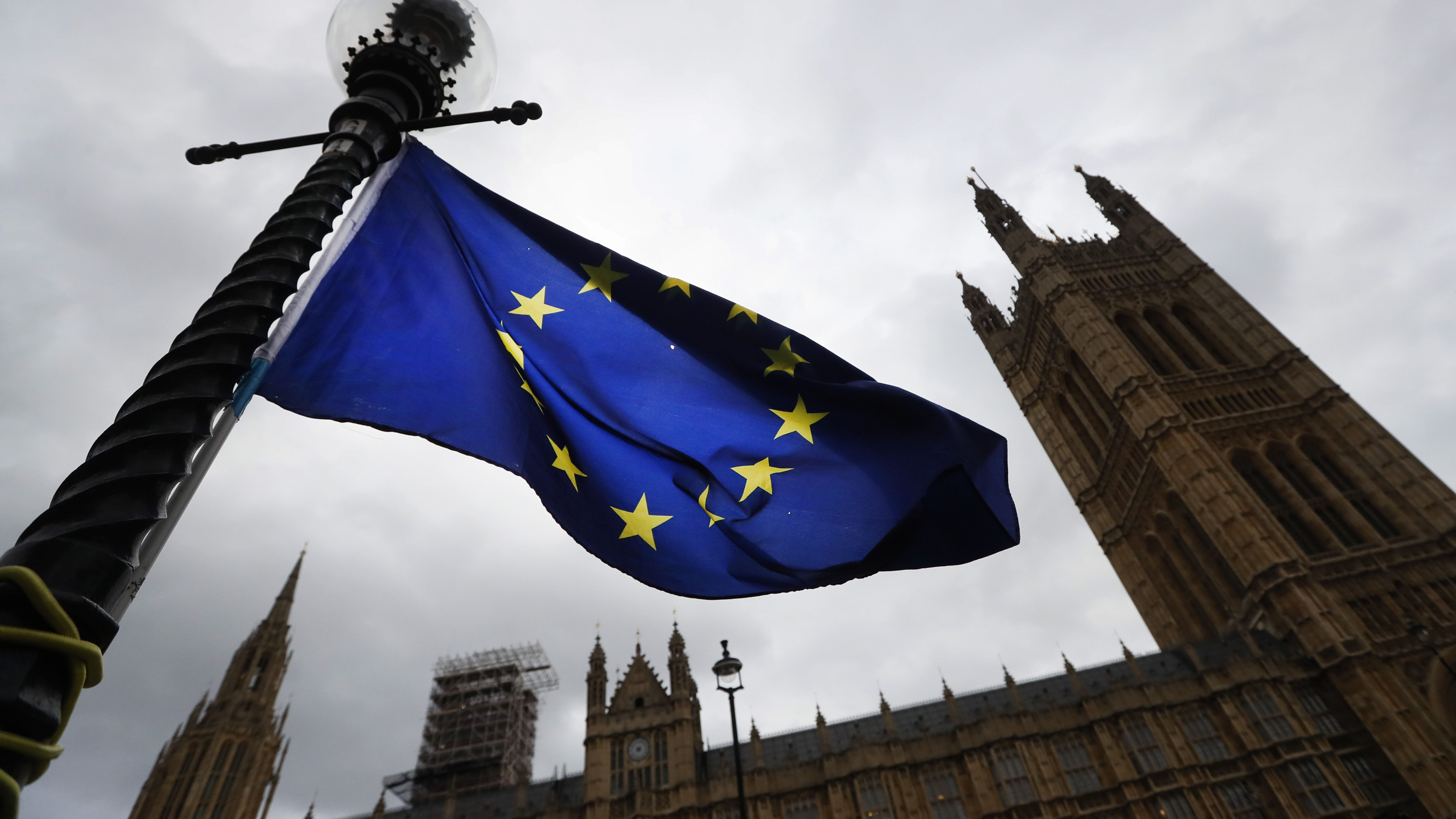 """A European Union flag flies near Parliament in London, Wednesday, Nov. 22, 2017. Britain's Treasury chief has little room to maneuver Wednesday as he reveals his spending plans to a nation bracing for the shock of Brexit. While Philip Hammond is promising to tackle a bleak economic outlook """"head on,"""" a slowing economy and stubborn deficit mean there is little money available to increase spending in the face of demands from teachers, firefighters, the National Health Service and the military.  (AP Photo/Kirsty Wigglesworth)"""