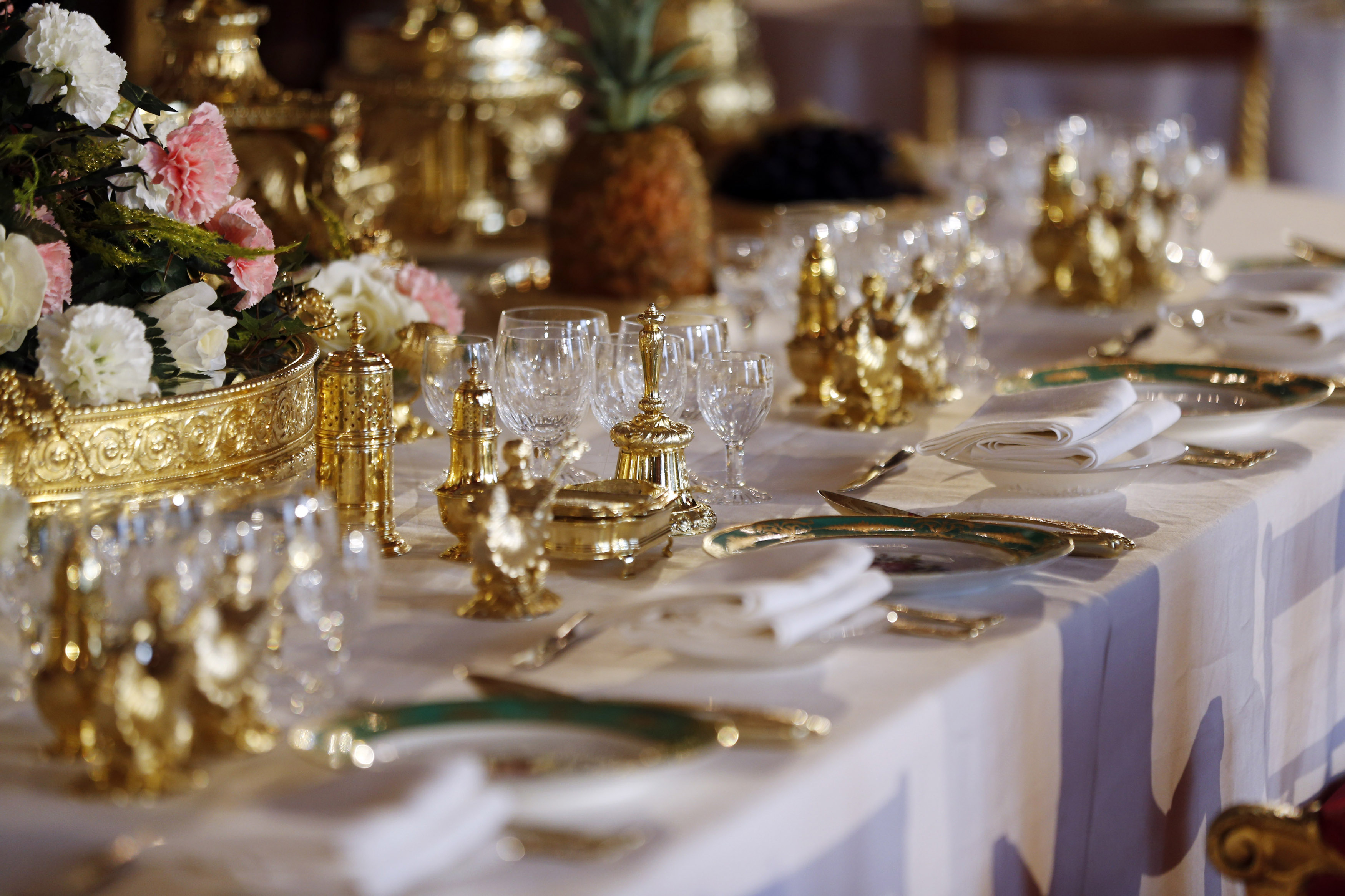 A table dressed to evoke the settings of Britain's Queen Elizabeth II's 1953 Coronation State Banquets.
