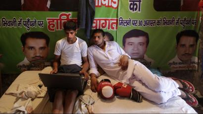 Indians looking at laptop