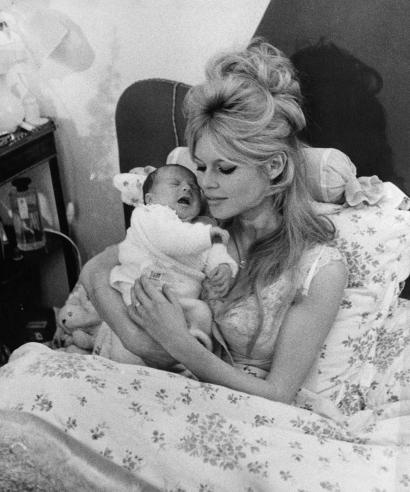 Brigitte Bardot holds her new son Nicolas in her Paris apartment January 13, 1960. The seven-pound boy born Jan.11, 1960 is her first. The French screen actress is married to actor Jacques Charrier. (AP Photo)
