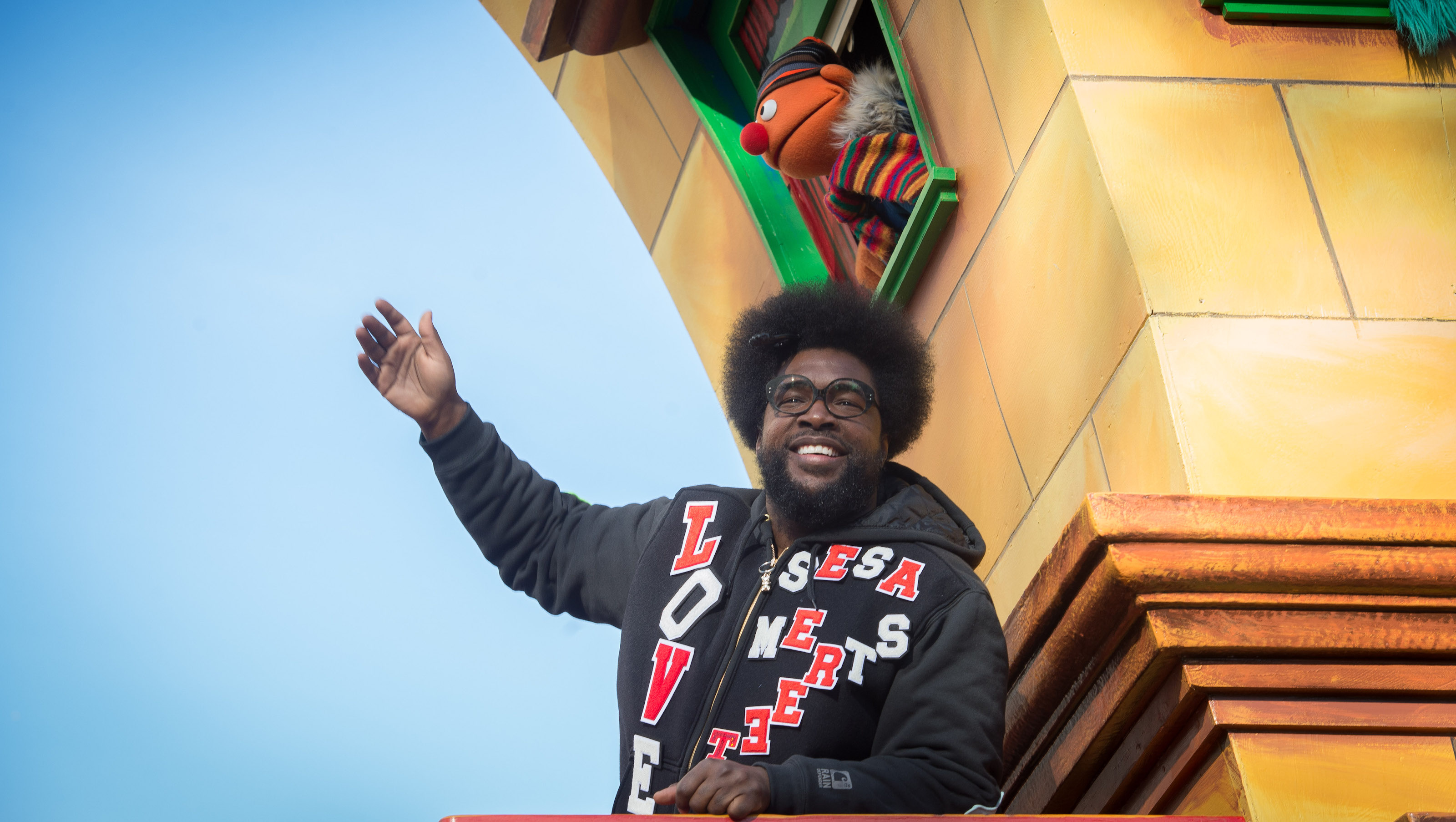 Questlove waves from a float during the Macy's Thanksgiving Day Parade, Thursday, Nov. 26, 2015, in New York. (AP Photo/Bryan R. Smith)