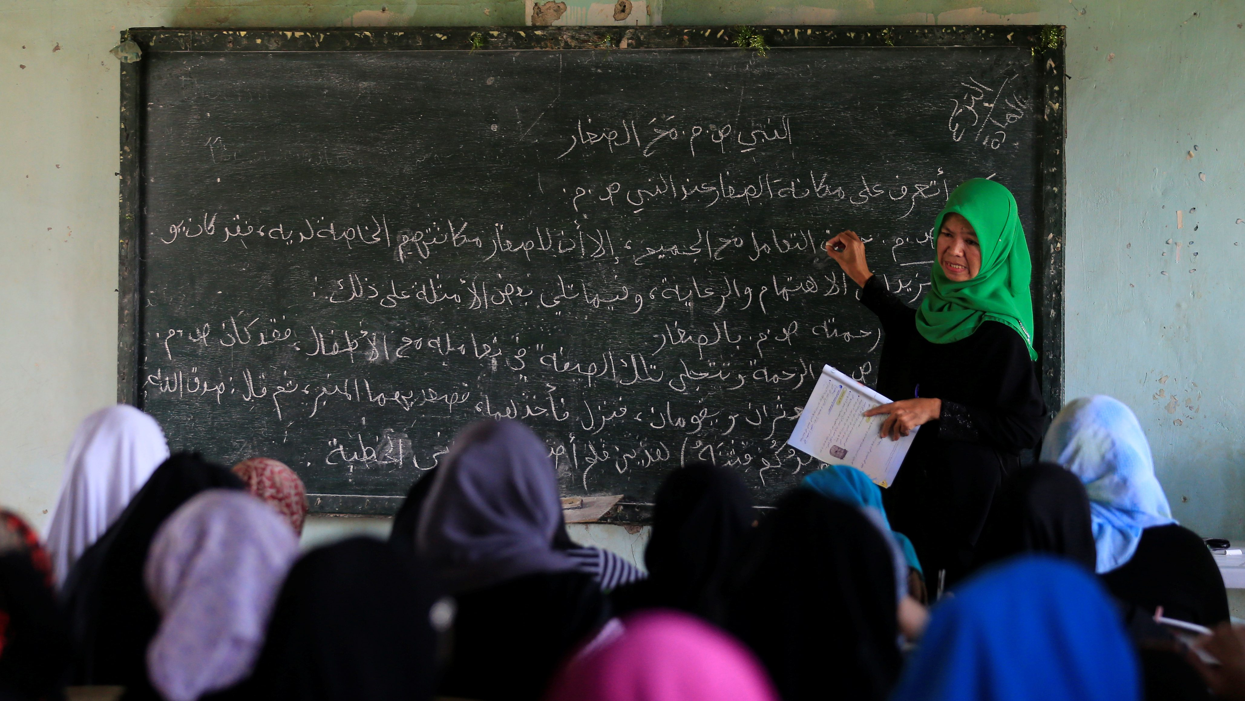 A teacher teaches Arabic language to Muslim students inside a classroom at Al-Markazie islamic institute in Balo-i town, Lanao Del Norte, southern Philippines, September 9, 2017. Picture taken September 9, 2017.