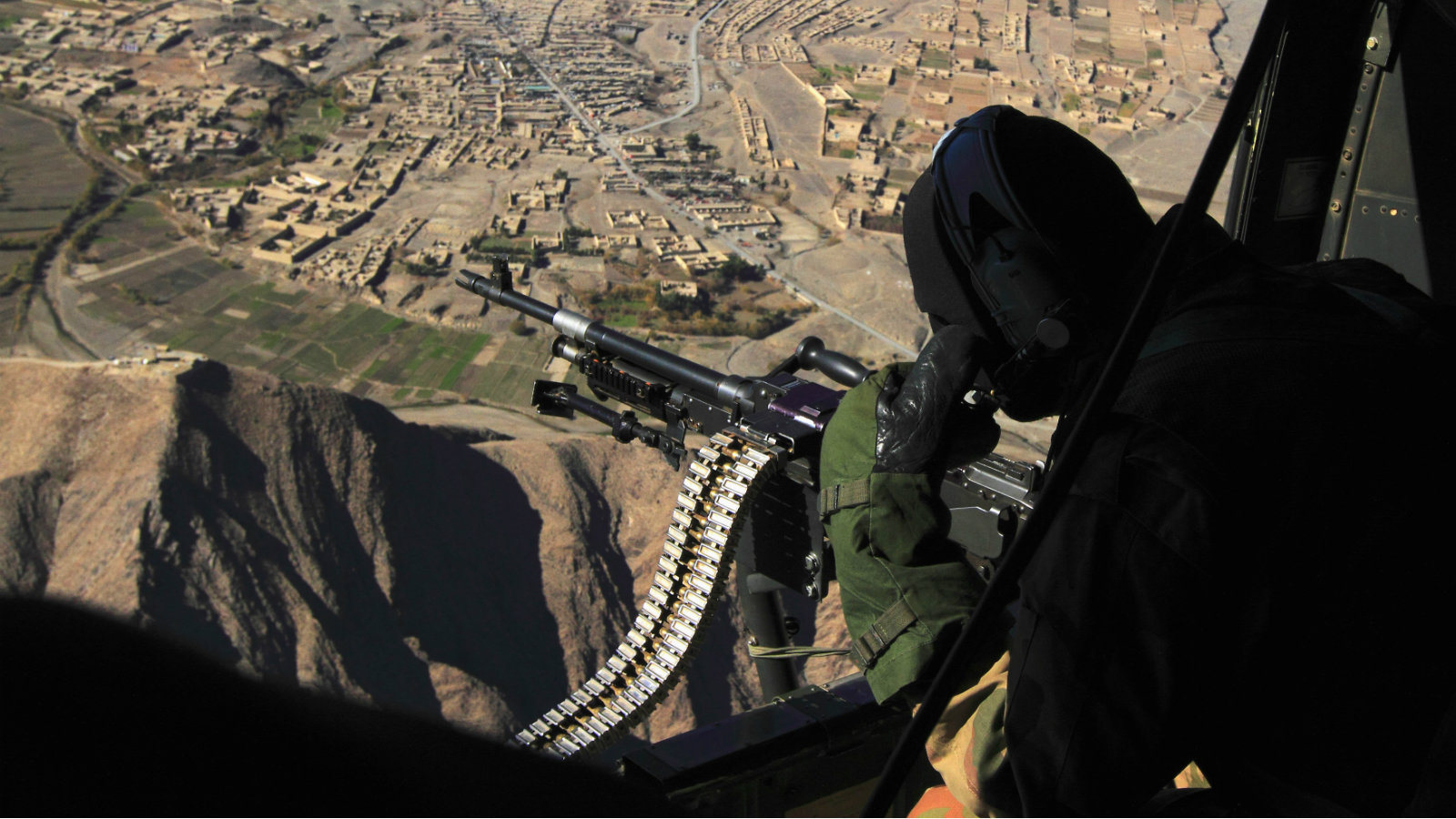 A Pakistani soldier mans a machine gun on a military helicopter.