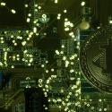 Illustration of a copy of bitcoin standing on PC motherboard