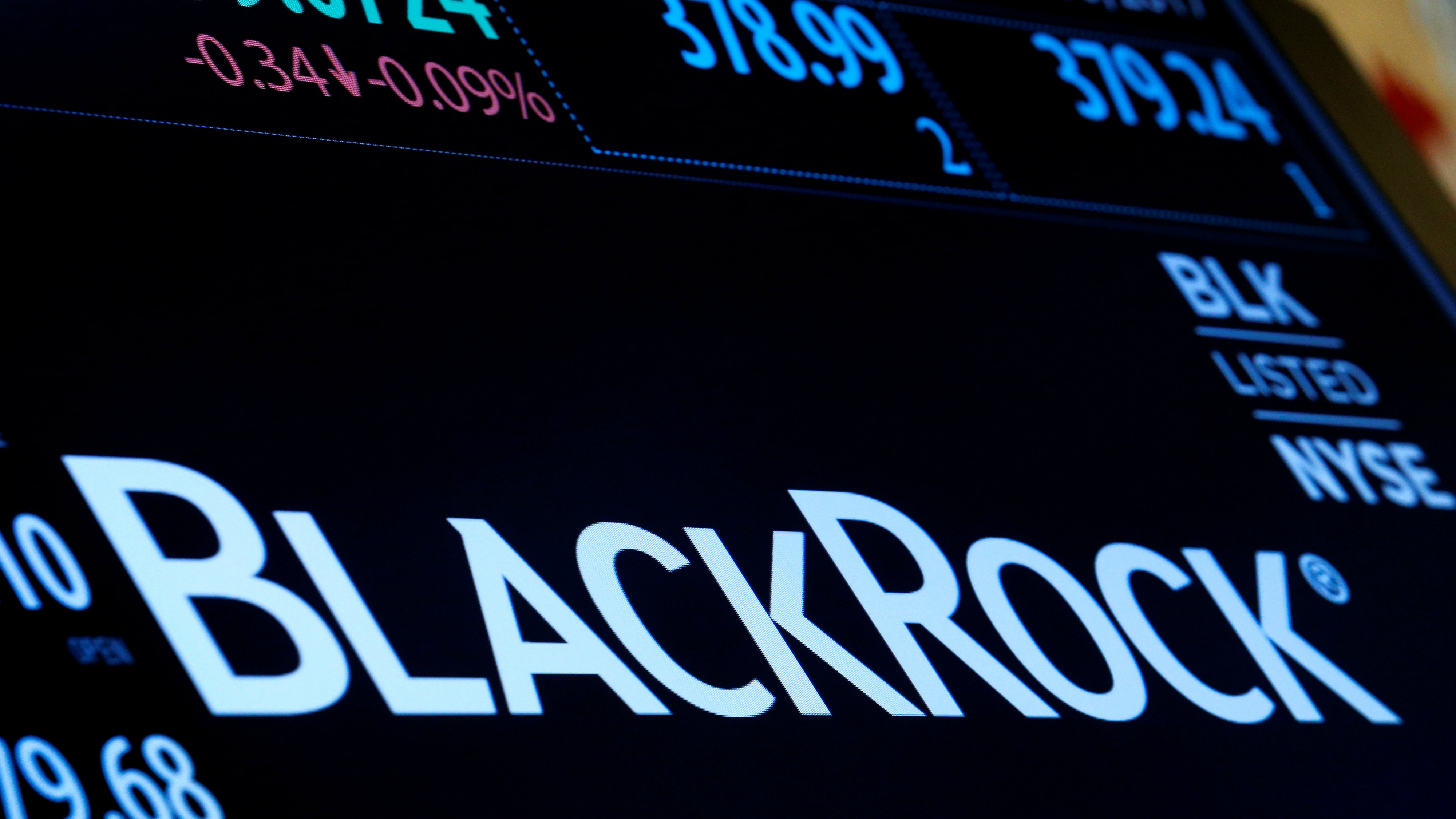 The company logo and trading information for BlackRock is displayed on a screen on the floor of the New York Stock Exchange (NYSE) in New York, U.S., March 30, 2017.