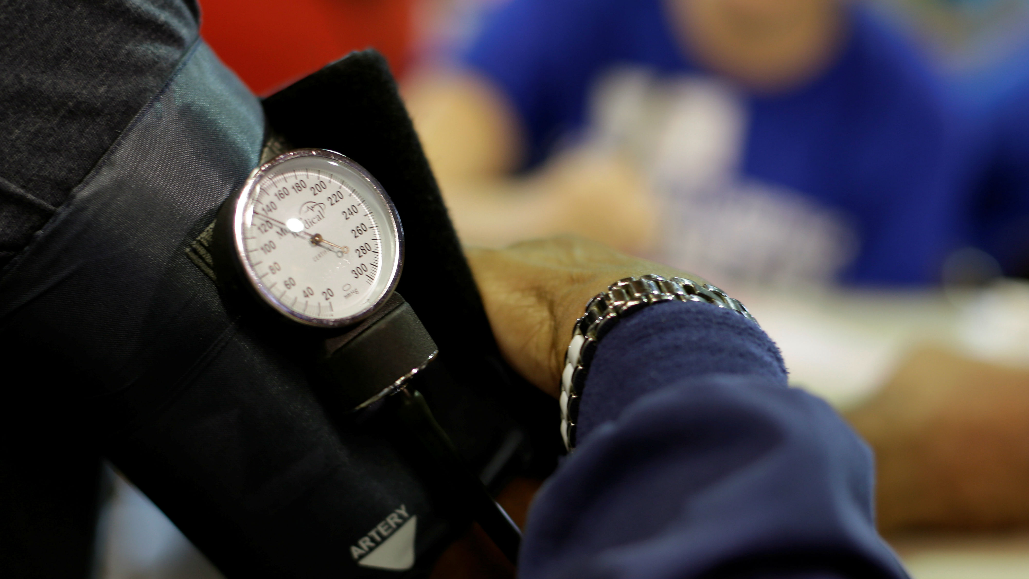 A man has his blood pressure checked at the Remote Area Medical Clinic in Wise, Virginia, U.S., July 22, 2017.
