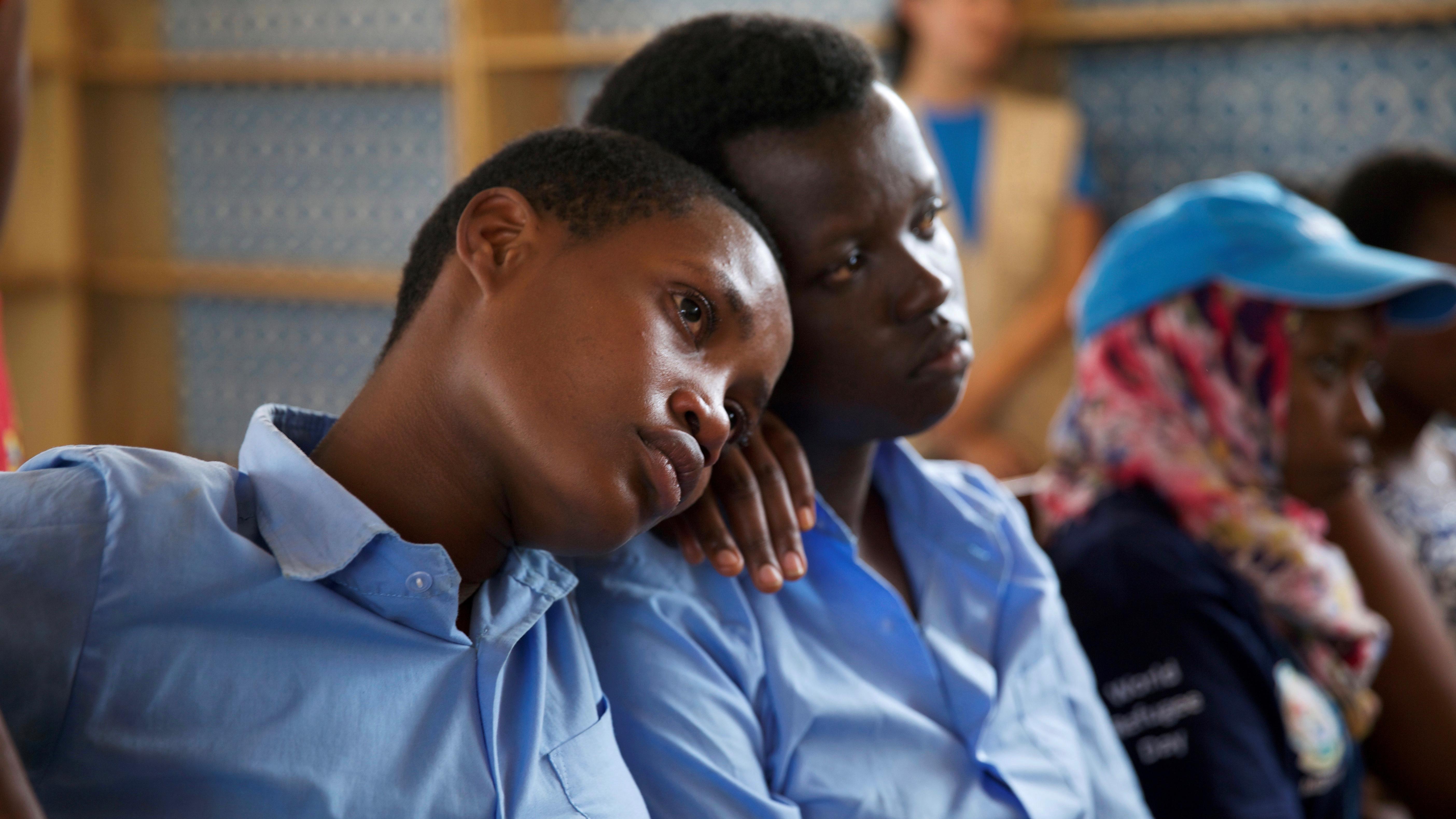 Burundian refugee school girls listen to Pakistani Nobel Peace Prize laureate Malala Yousafzai at the Mahama refugee camp, Rwanda, July 14, 2016. Picture taken July 14, 2016. REUTERS/Katy Migiro - S1AETPSGAHAB