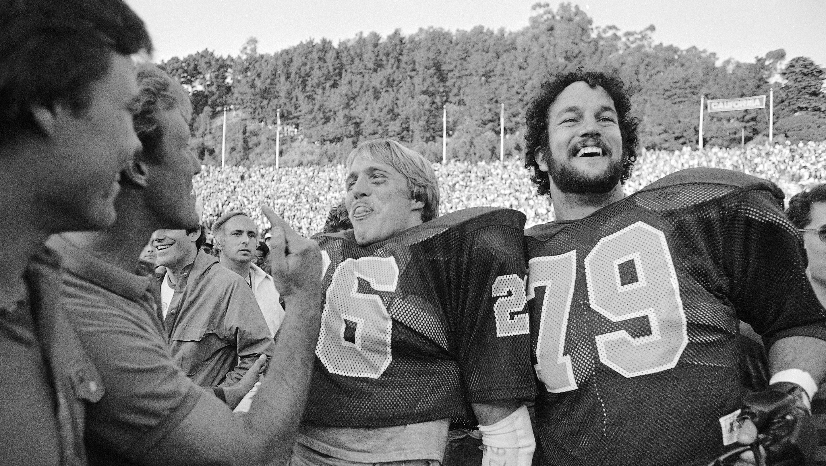 Cal's Kevin Moen center (26), and Keith Kartz (79) are all smiles after Cal defeated Stanford, 25-20 on Nov. 20, 1982 in Berkeley. Cal?s Kevin Moen weaved his way through hundreds of people and scored a touchdown after time had run out to give Cal the win.