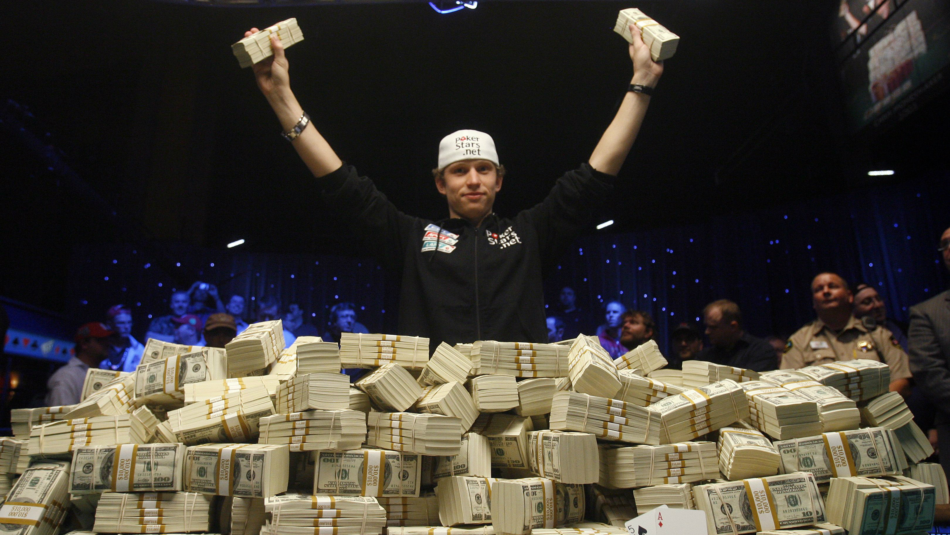 A poker player in front a pile of cash.
