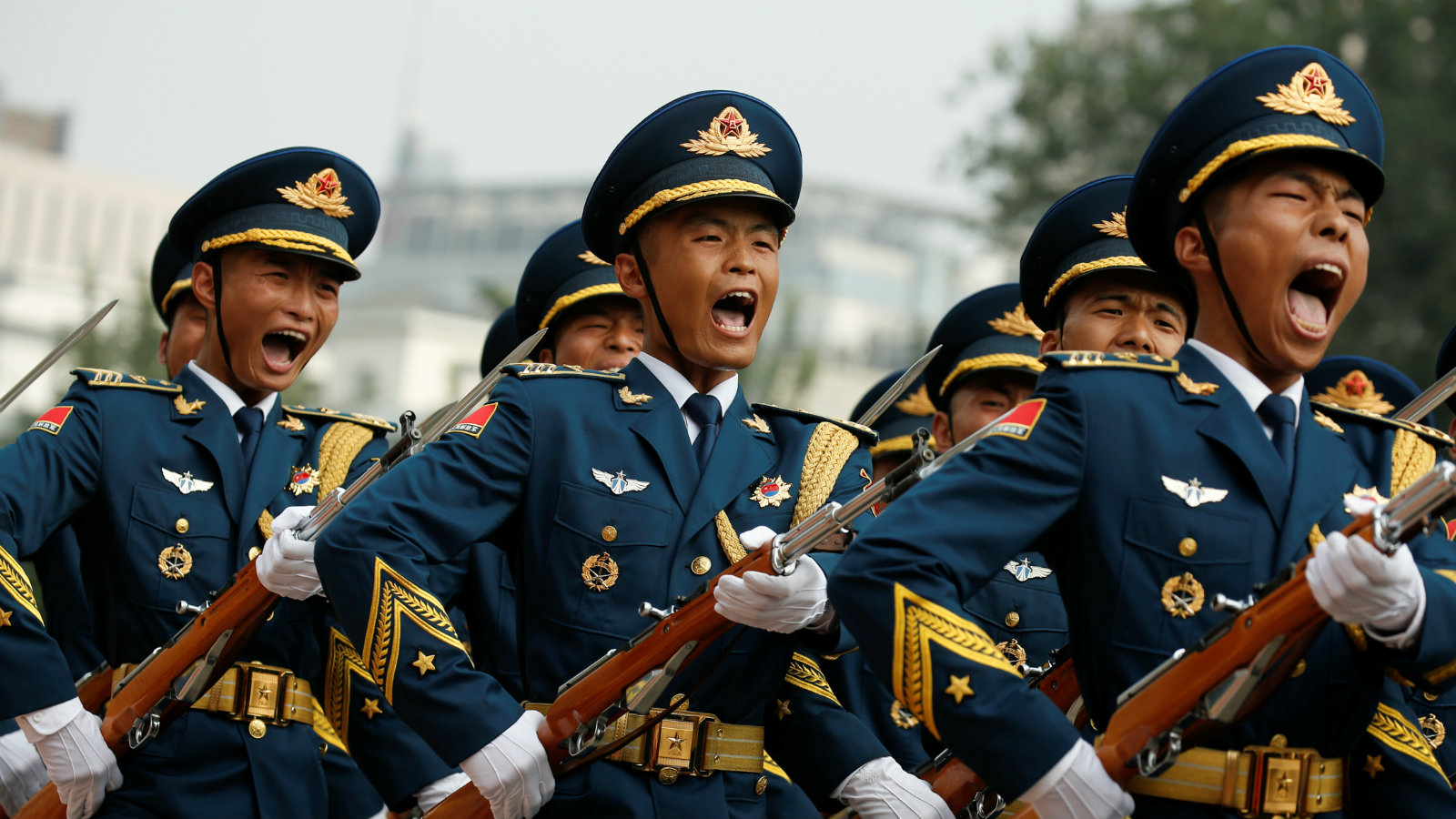 Marching honour guards shout as Chairman of U.S. Joint Chiefs of Staff Joseph Dunford is welcomed by his Chinese counterpart, chief of the general staff of the Chinese People's Liberation Army Gen. Fang Fenghui, during a welcoming ceremony in Beijing, China August 15, 2017.