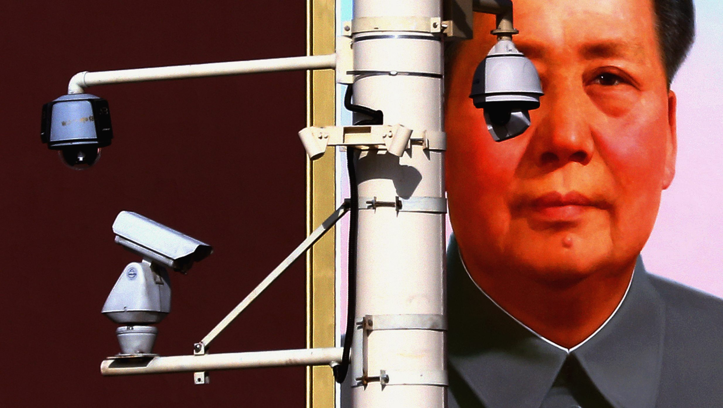 Security cameras are attached to a pole in front of the giant portrait of former Chinese Chairman Mao Zedong on Beijing's Tiananmen Square, near the Great Hall of the People where the 18th National Party Congress (NPC) is currently being held, November 11, 2012.     REUTERS/David Gray
