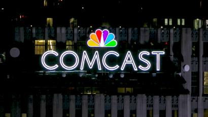 A Comcast sign on a building.