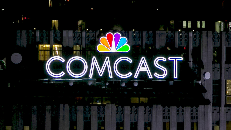 A Comcast sign on a building.