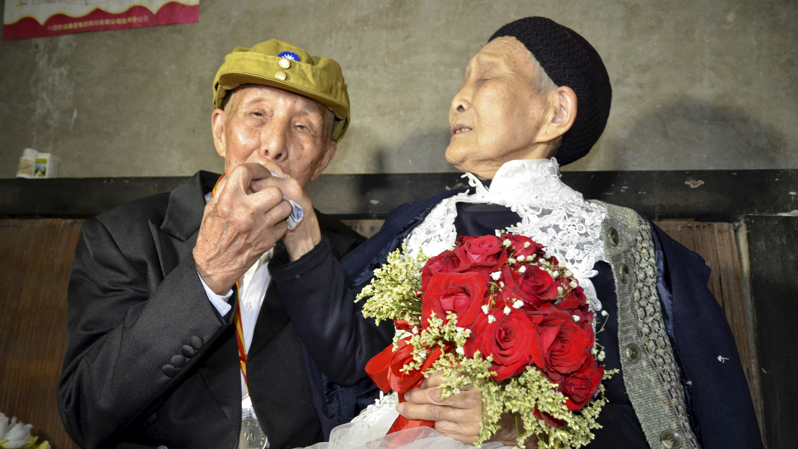 An elderly Chinese couple.