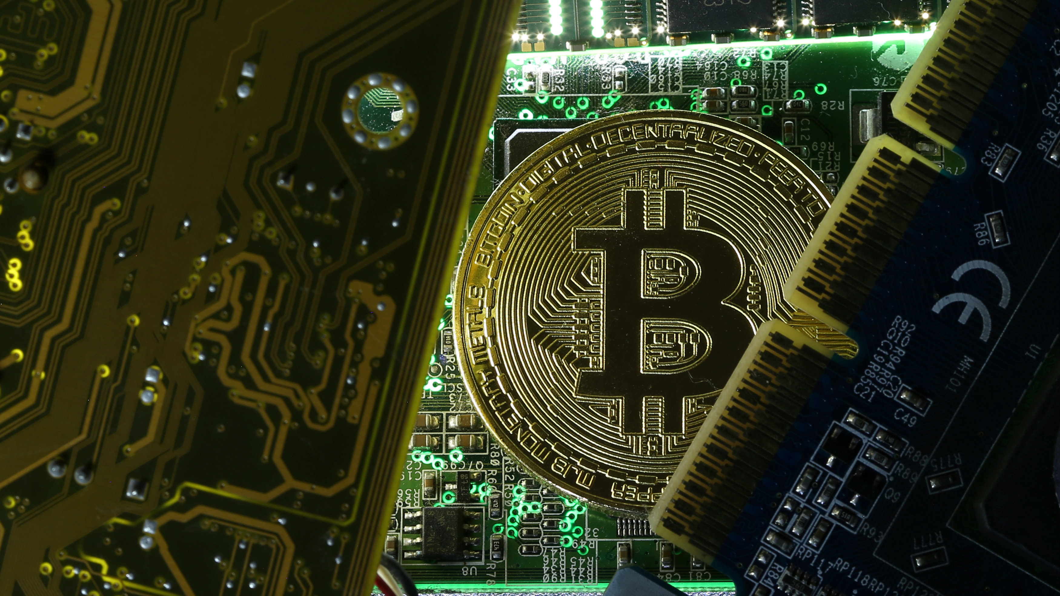 A copy of bitcoin standing on PC motherboard is seen in this illustration picture, October 26, 2017. Picture taken October 26, 2017.