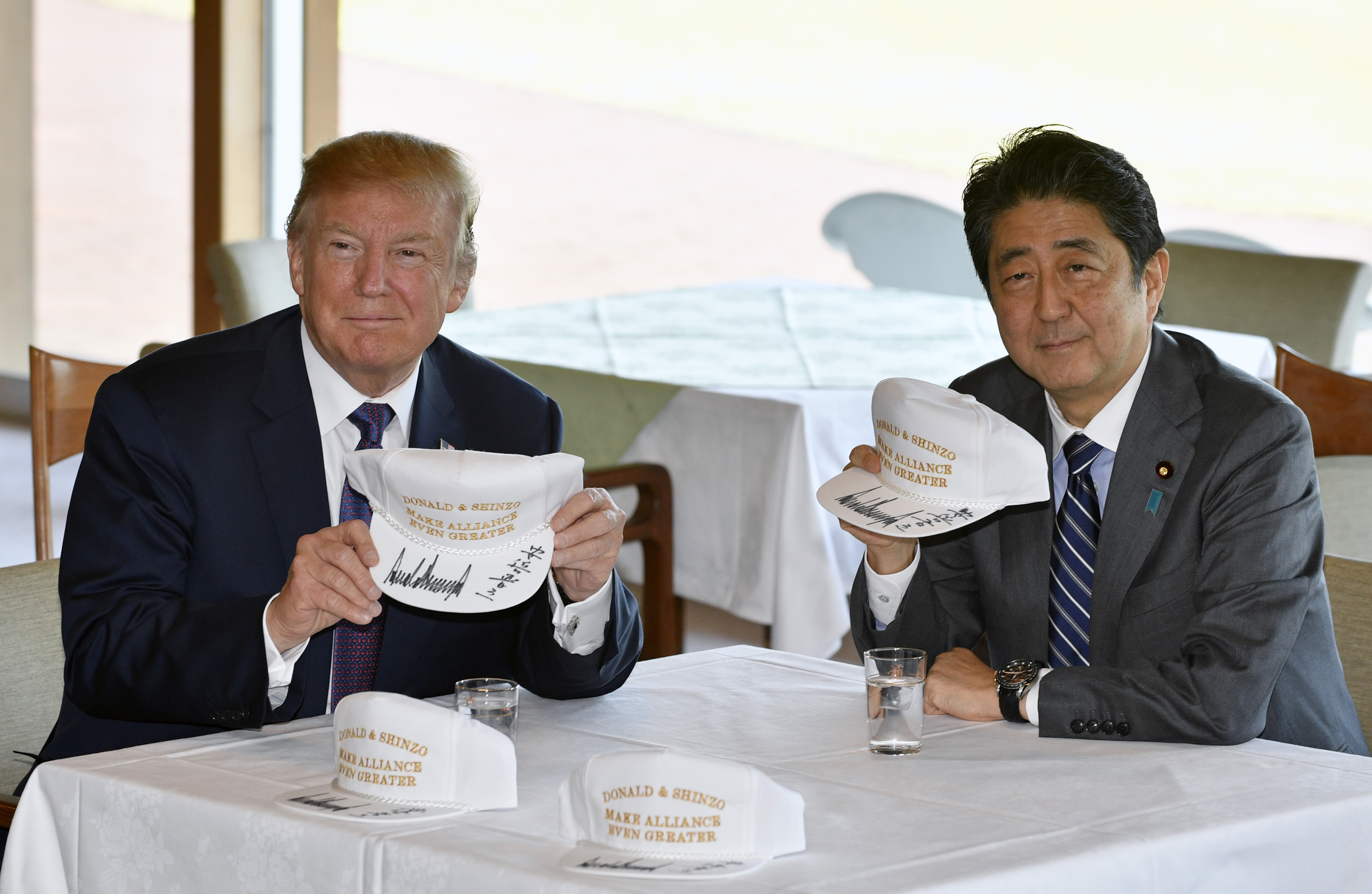 US President Donald J. Trump (L) and Japanese Prime Minister Shinzo Abe (R) pose after they signed hats reading 'Donald and Shinzo, Make Alliance Even Greater' at the Kasumigaseki Country Club in Kawagoe, Japan, 05 November 2017. Trump's visit to Japan is the first stop of his 12-day tour of Asia. After Japan, Trump will visit South Korea, China, Vietnam and the Philippines.