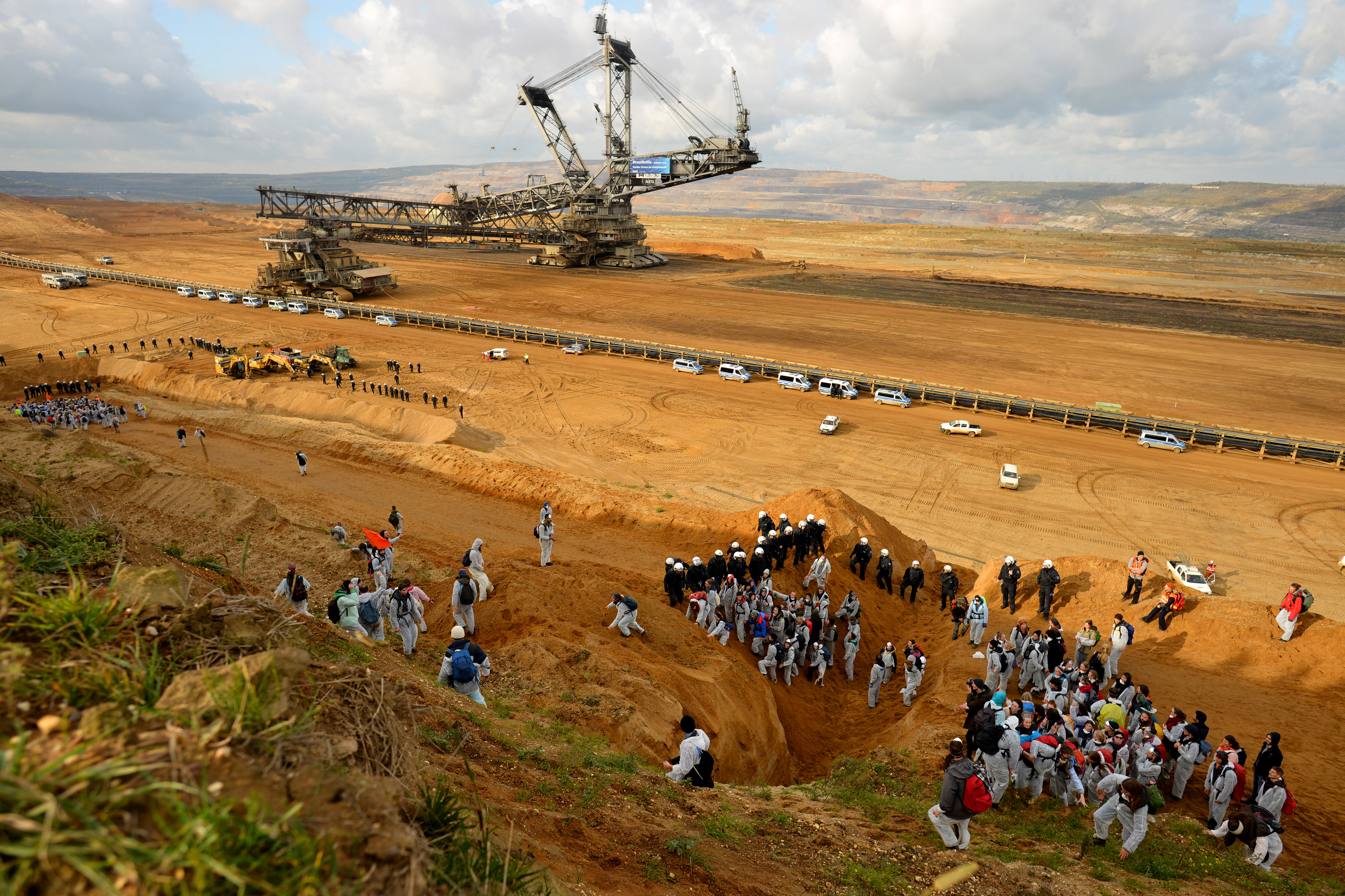 Protesters of climate activists group 'Ende Gelaende' try to blockade coal operations at Hambach opencast mining in the Rhineland prior to the UN Climate Change Conference COP23, close to Kerpen, Germany, 05 November 2017. The 23rd session of the United Nations Framework Convention on Climate Change Conference (UNFCCC), the 2017 UN Climate Change Conference COP23 will take place from 06 to 17 November in Bonn, the seat of the Climate Change Secretariat, under the presidency of Fiji.