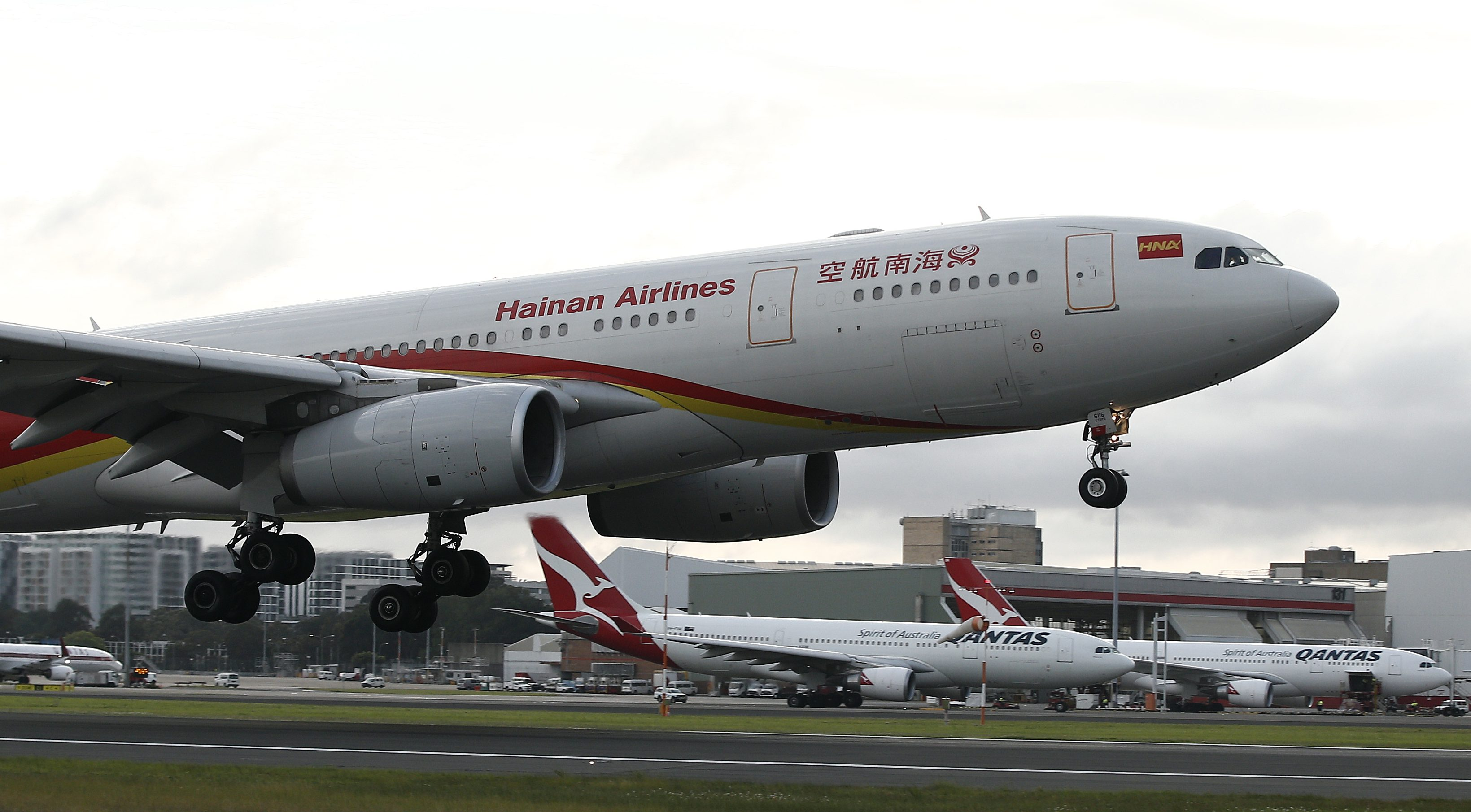 Hainan Airlines' new service from Changsha to Sydney touches down for the first time at Sydney Airport in Australia, Tuesday, Sept 13, 2016. The airline will run a twice-weekly service operated by an A330-200 aircraft with 250 seats. (AP Photo/Rob Griffith)