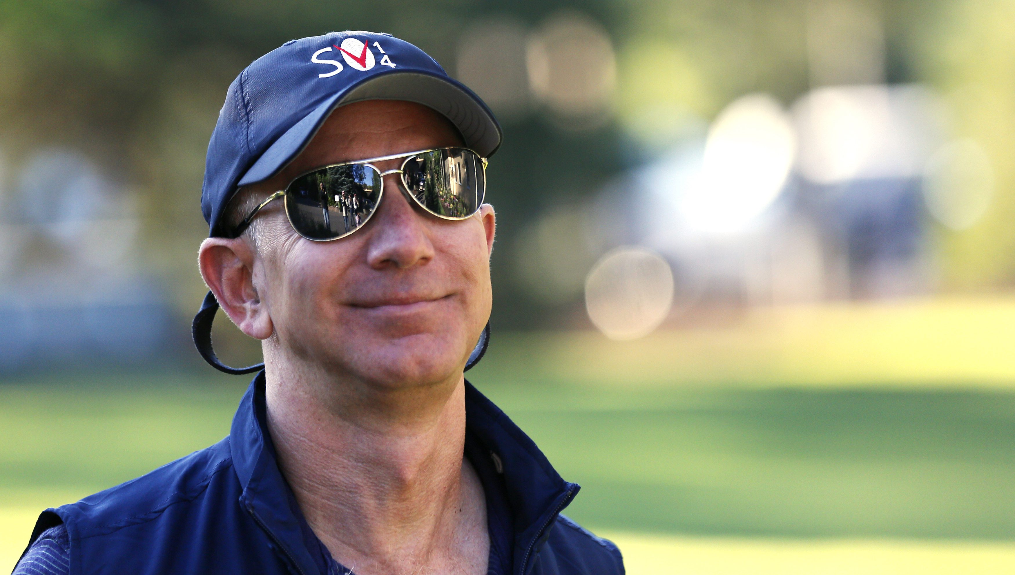 Jeff Bezos, founder and CEO of Amazon.com, arrives for the third day of the Allen and Co. media conference in Sun Valley, Idaho July 11, 2014. Media and technology CEOs and investors get together every year at the Allen & Co conference in Sun Valley for a week of mingling and deal-making at the upscale Idaho mountain resort. REUTERS/Rick Wilking (UNITED STATES - Tags: BUSINESS MEDIA SCIENCE TECHNOLOGY) - RTR3Y7OD