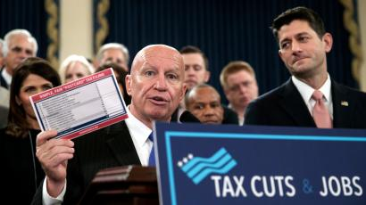 "House Ways and Means Committee Chairman Kevin Brady, R-Texas, joined by Speaker of the House Paul Ryan, R-Wis., right, holds a proposed ""postcard tax filing form"" as they unveil the GOP's far-reaching tax overhaul, the first major revamp of the tax system in three decades, on Capitol Hill in Washington, Thursday, Nov. 2, 2017."