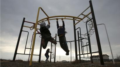Children playing on a playground.