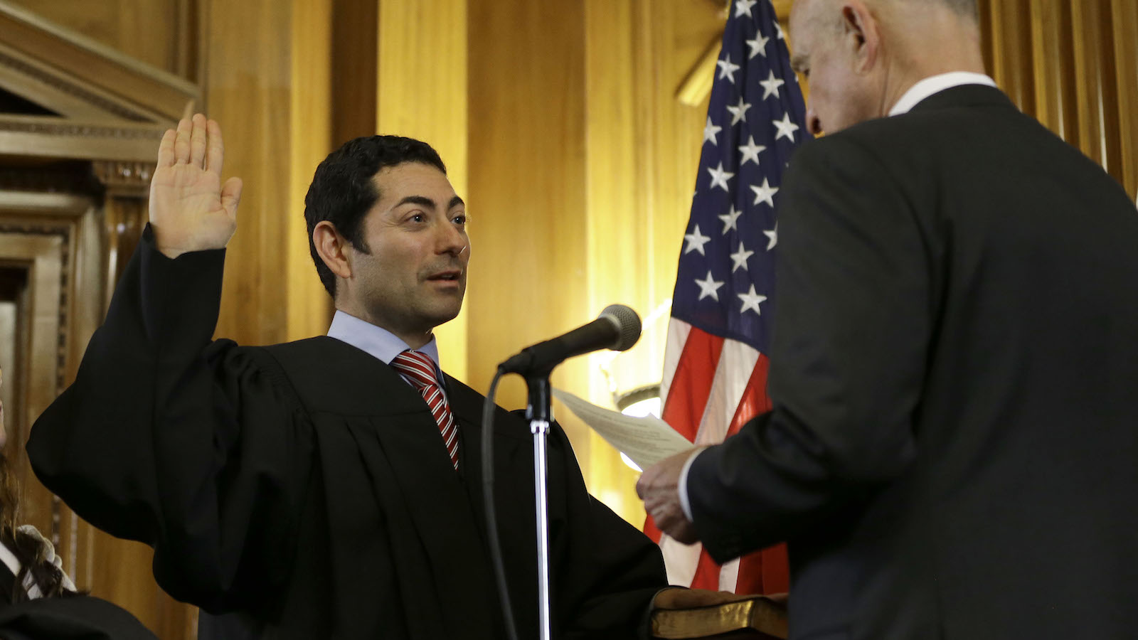 Mariano-Florentino Cuellar, left, is sworn in as an associate justice to the California Supreme Court by Gov. Jerry Brown during an inauguration ceremony in Sacramento, Calif., Monday, Jan. 5,  2015. (AP Photo/Rich Pedroncelli)