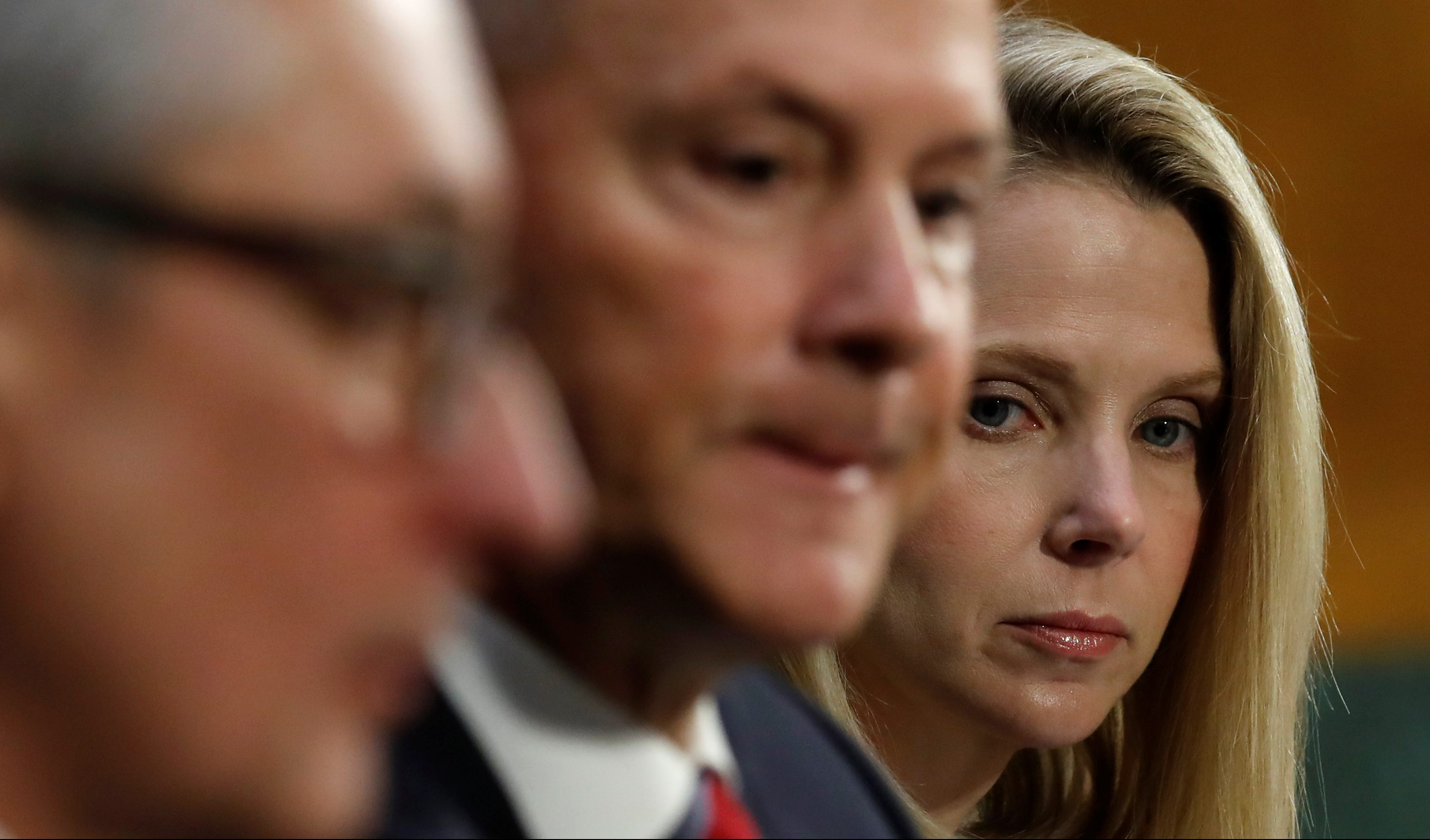 "Equifax Interim CEO Paulino Barros (L), former Equifax CEO Richard Smith (C) and former Yahoo Chief Executive Marissa Mayer testify before a Senate Commerce, Science and Transportation hearing on ""Protecting Consumers in the Era of Major Data Breaches"" on Capitol Hill in Washington, U.S., November 8, 2017.  REUTERS/Kevin Lamarque - RC1AF7341600"