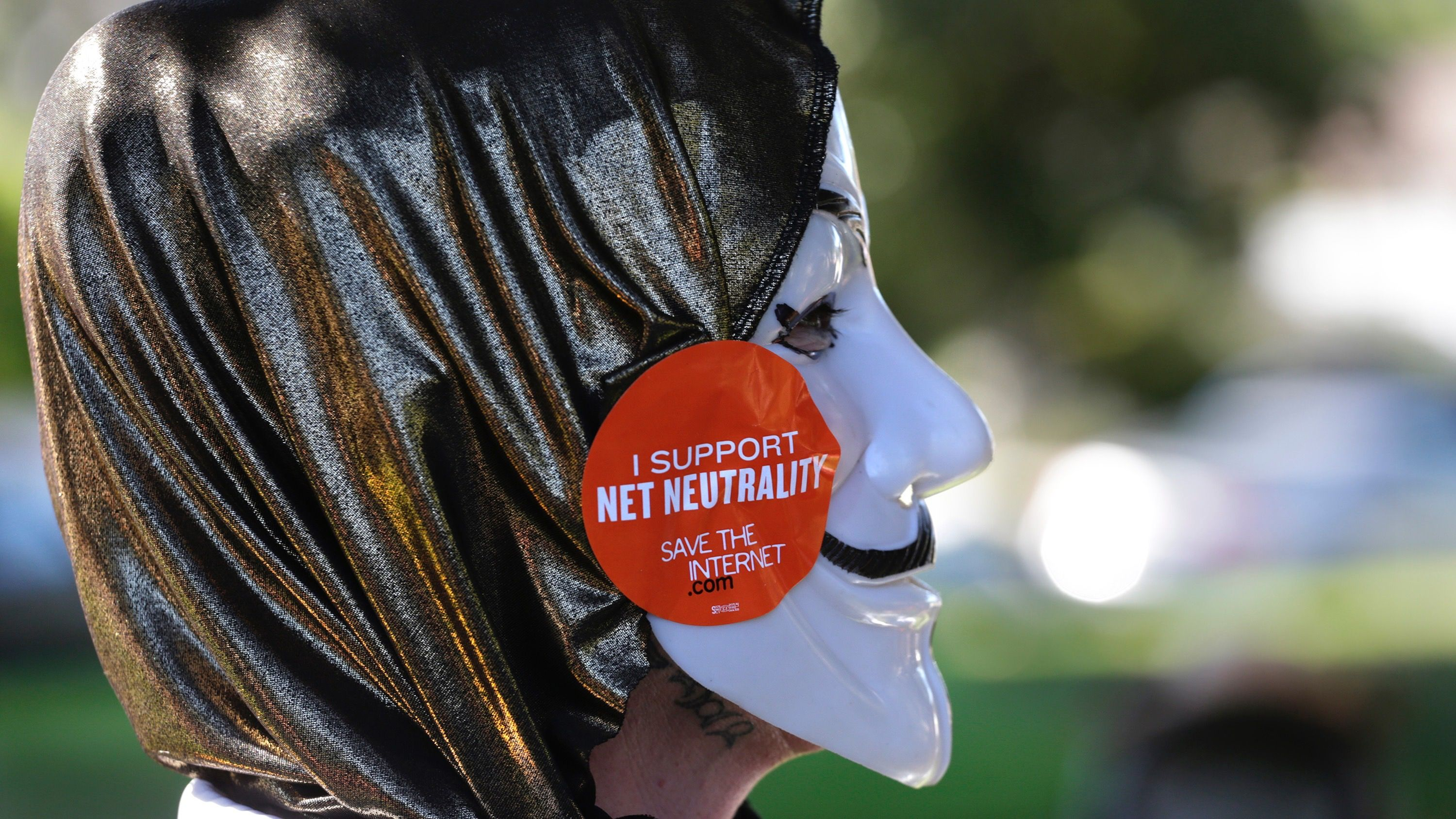A pro-net neutrality Internet activist attends a rally in the neighborhood where U.S. President Barack Obama attended a fundraiser in Los Angeles, California July 23, 2014.