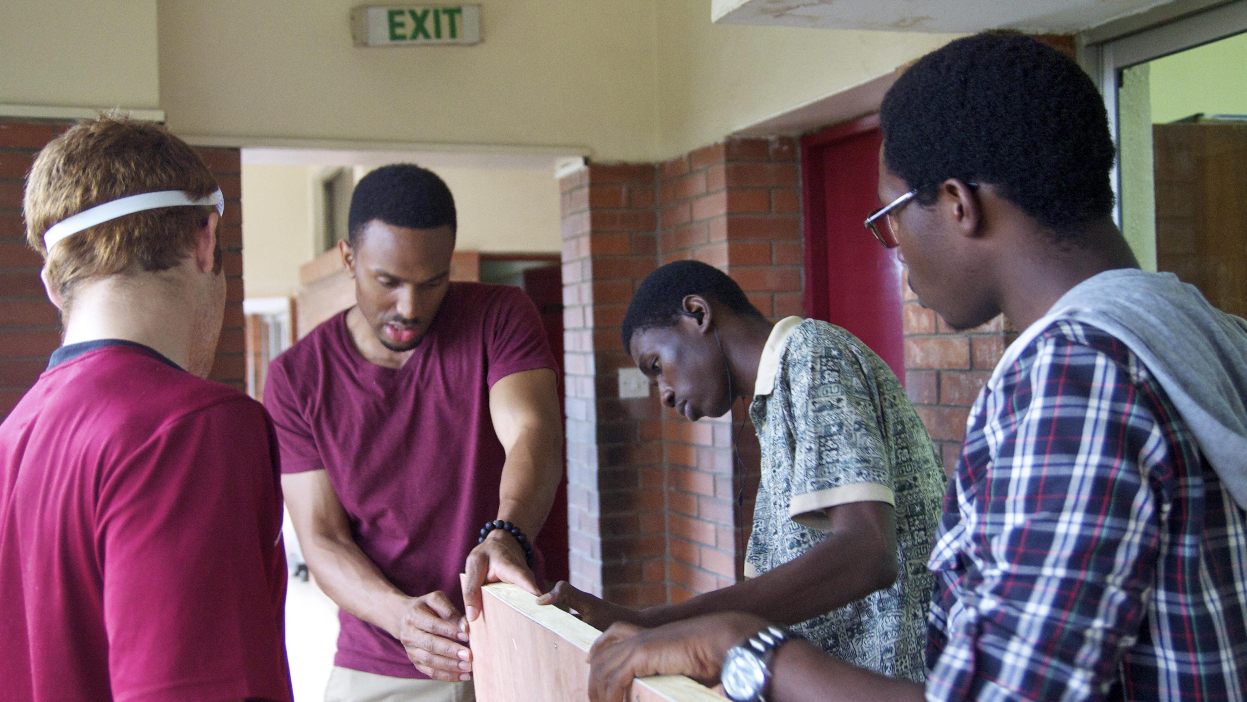 Obinna Ukwuani working with NESA staff