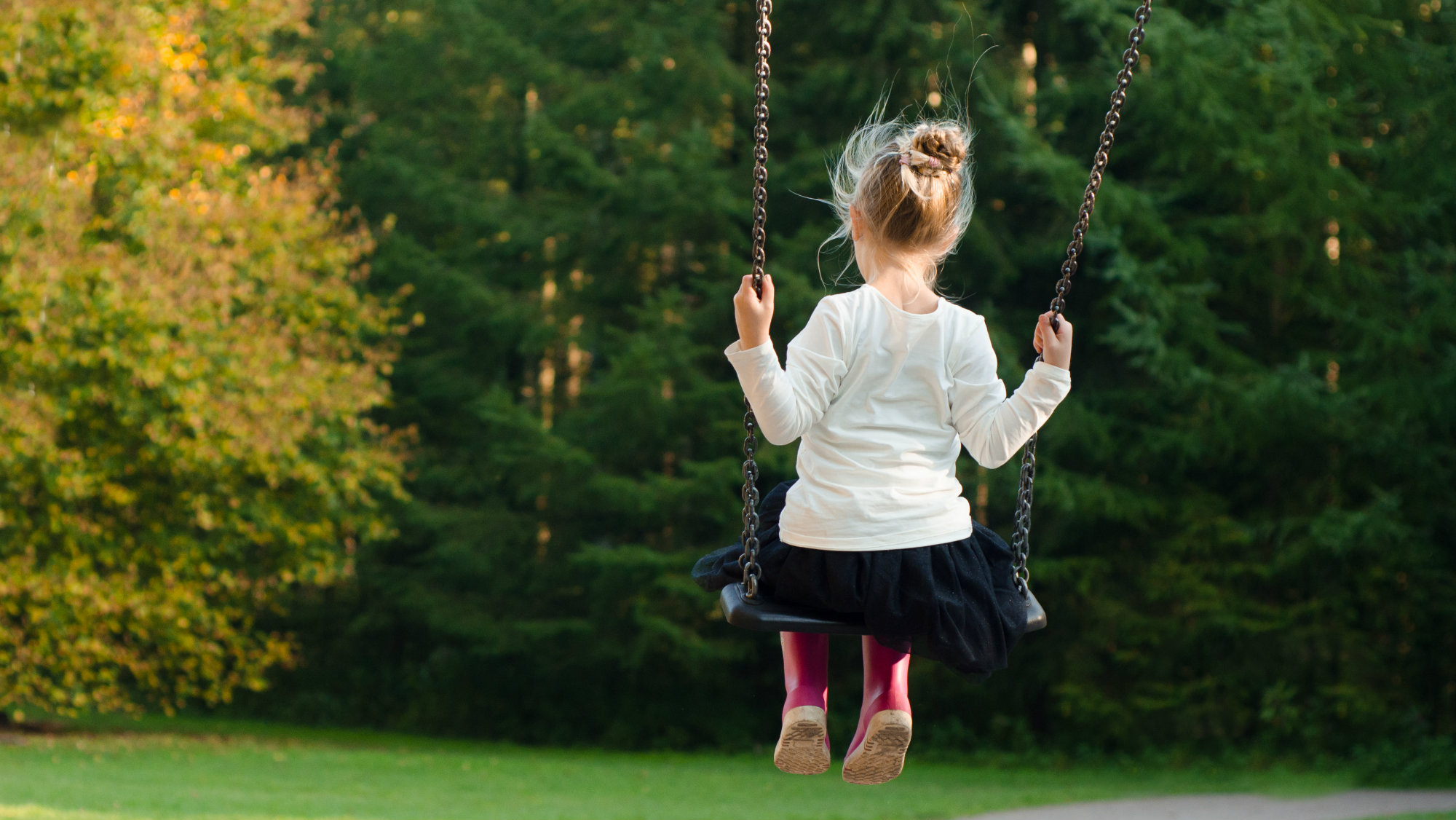 Image of a girl on a swing
