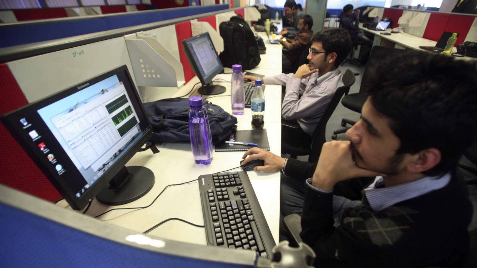 Employees of Snapdeal.com, an Indian online discount shopping website, work inside their company office...