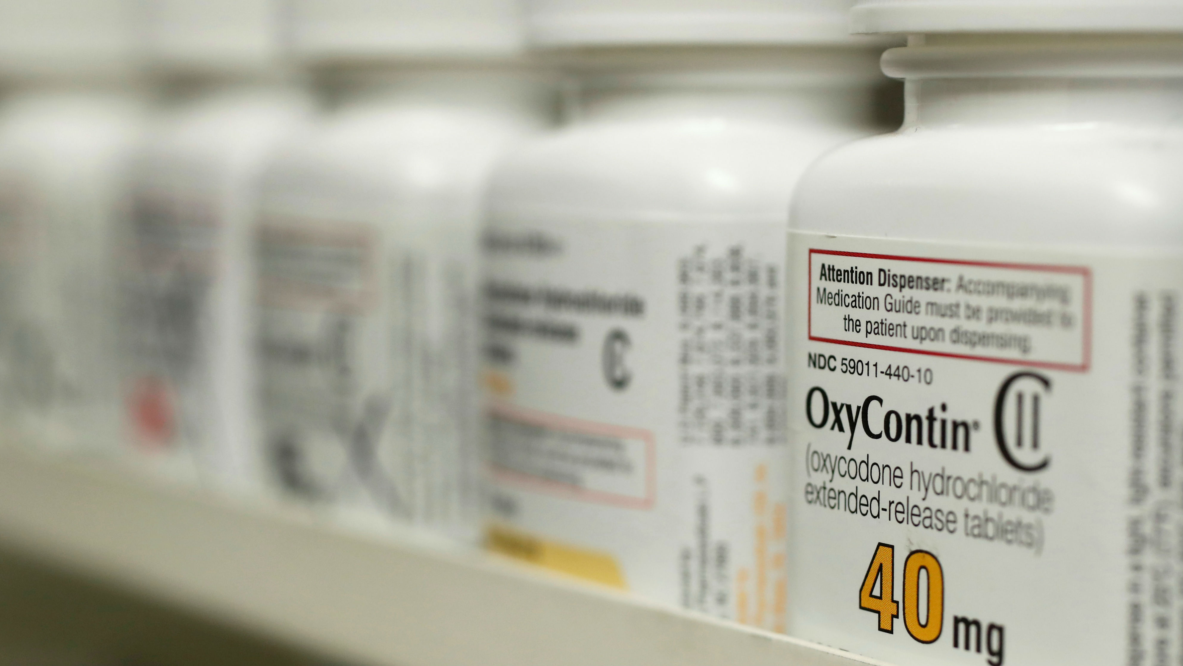 Bottles of prescription painkiller OxyContin, 40mg pills, made by Purdue Pharma L.D. sit on a shelf at a local pharmacy, in Provo, Utah, U.S., April 25, 2017.