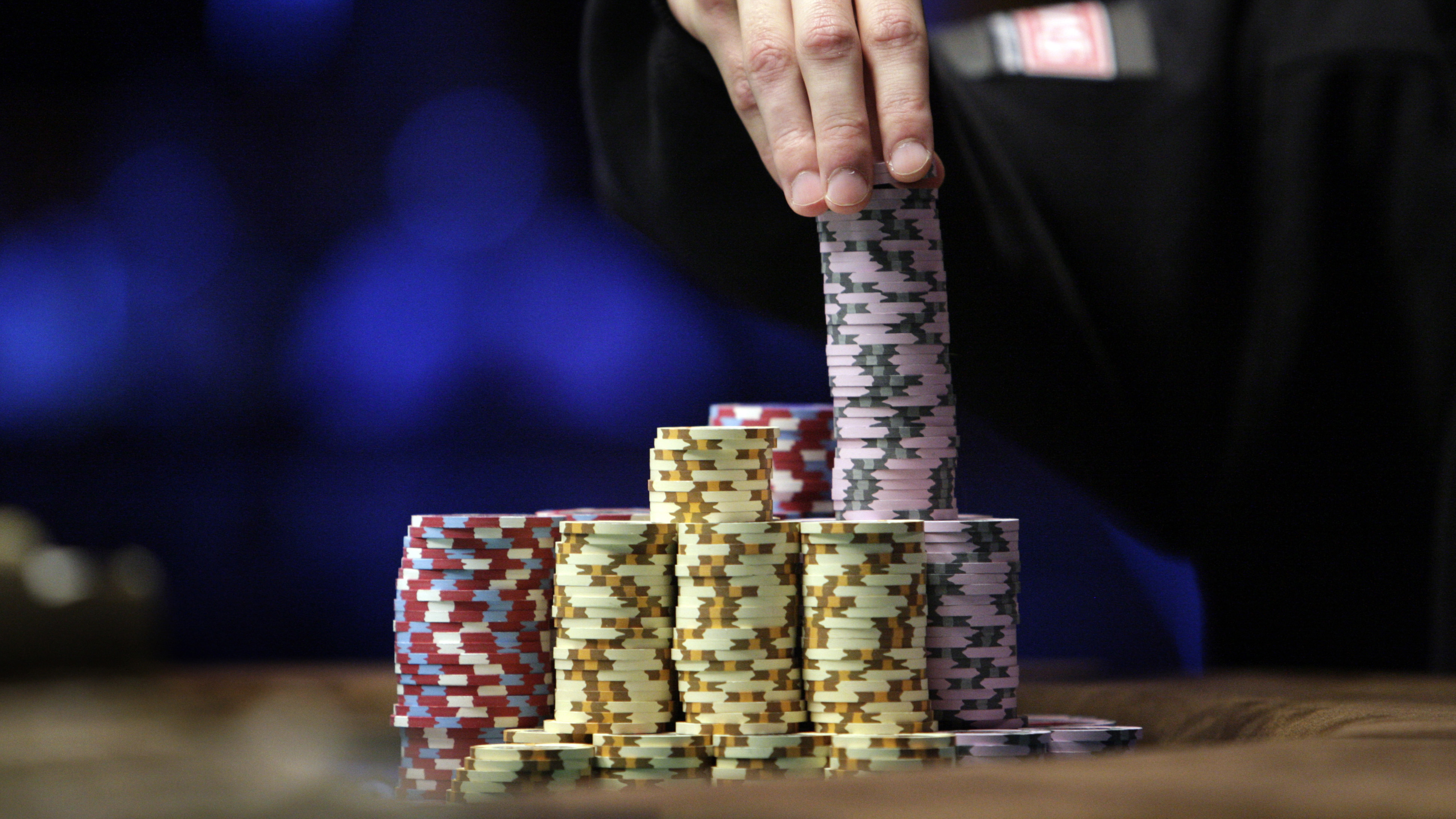 Jonathan Duhamel of Canada stacks chips as he plays against John Racener of the U.S. in the finals of World Series of Poker Main Event at the Rio hotel-casino in Las Vegas, Nevada November 8, 2010. Duhamel, 22, the first Canadian and the first French-speaking champion in the history of the World Series of Poker, won the bracelet and $8.9 million in prize money. REUTERS/Las Vegas Sun/Steve Marcus (UNITED STATES - Tags: SOCIETY) - GM1E6B91ADH01