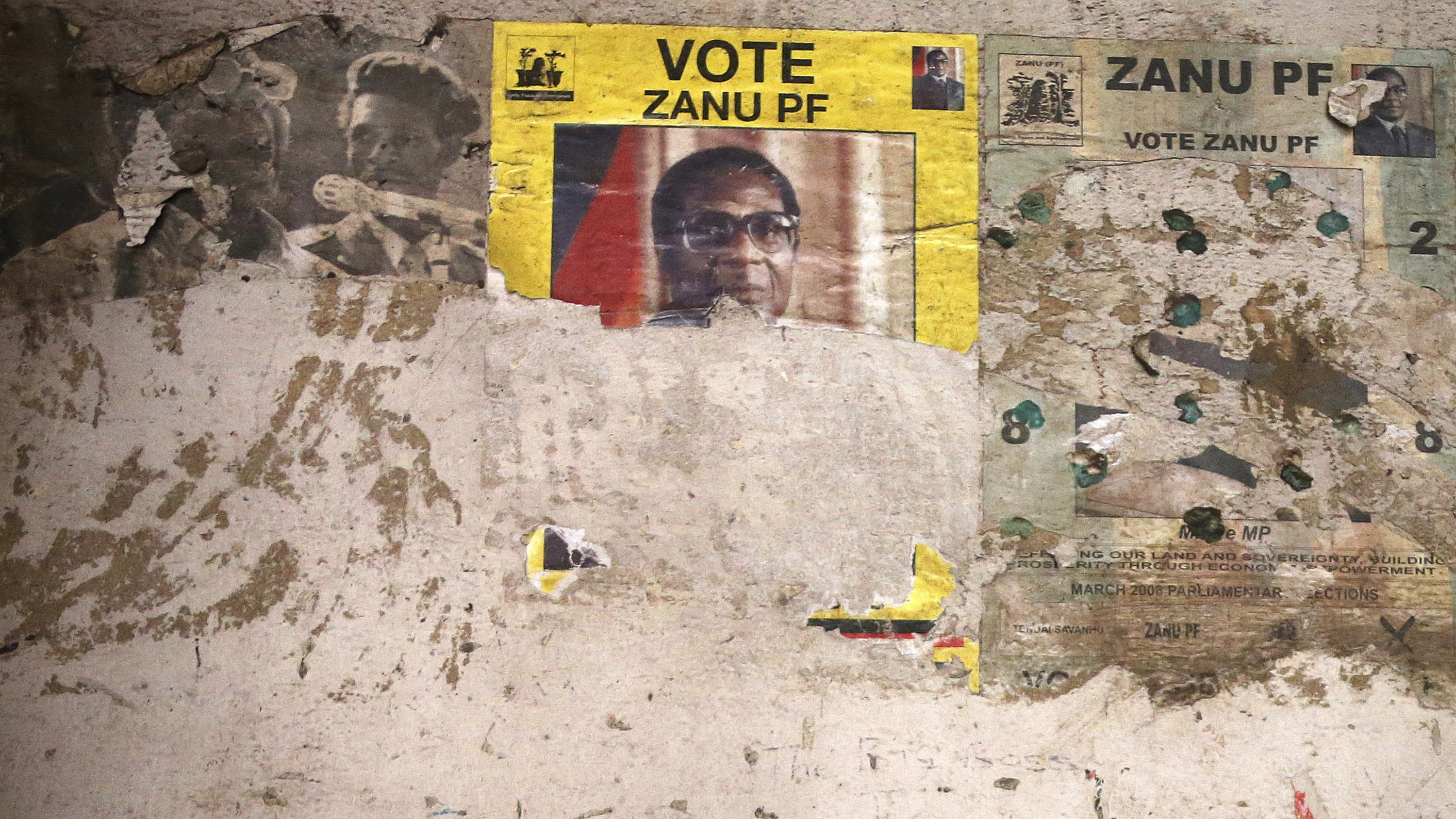 "An election poster from the 2008 Zanu Pf election campaign on the wall of a dilapidated old building in the Mbara suburb of Harare, Friday Nov. 17, 2017. Zimbabwe's military says it is making ""significant progress"" in talks with President Robert Mugabe for his departure while it pursues and arrests some allies of the leader and his wife. (AP Photo)"