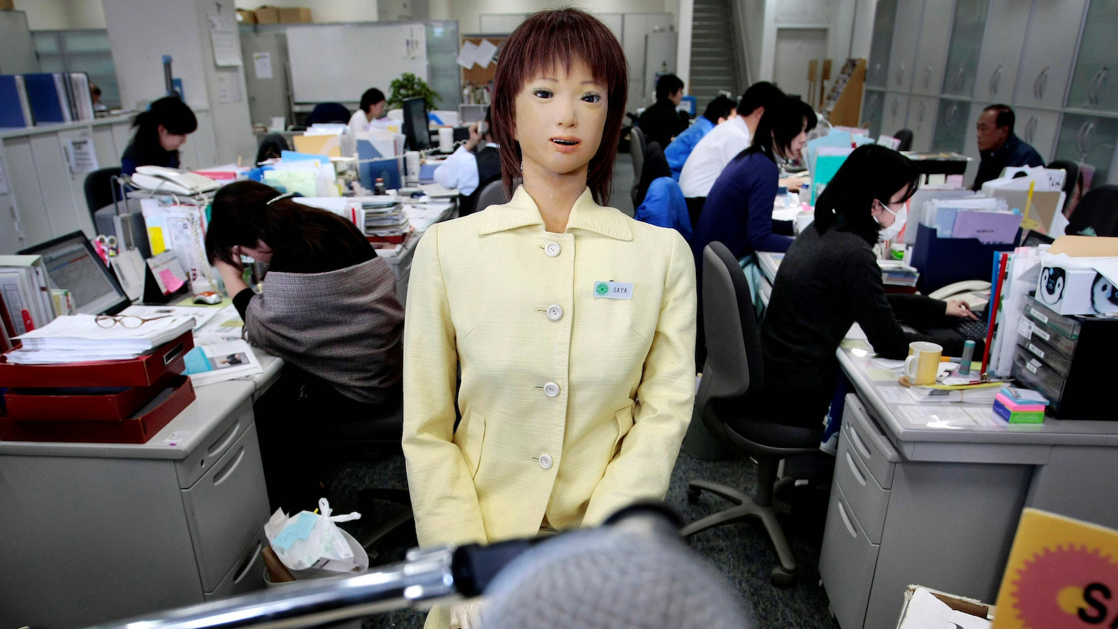 """Japan's robot Saya, developed by Hiroshi Kobayashi, Tokyo University of Science professor, works as a receptionist at the university's front desk in Tokyo, Japan, Wednesday, March 11, 2009. First developed as a receptionist robot in 2004, Saya was tested in a real Tokyo classroom earlier this year to a handful of fifth and sixth graders, although it still can't do much more than call roll and shout orders like """"Be quiet."""" (AP Photo/Itsuo Inouye)"""