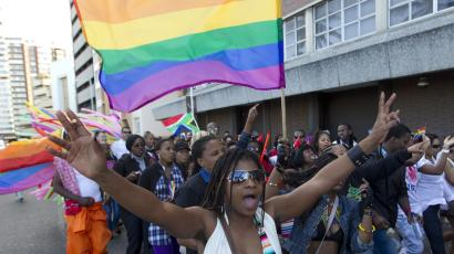 A woman holds her hands up during the Durban Pride parade where several hundred people marched through the Durban city centre in support of gay rights, July 30, 2011.