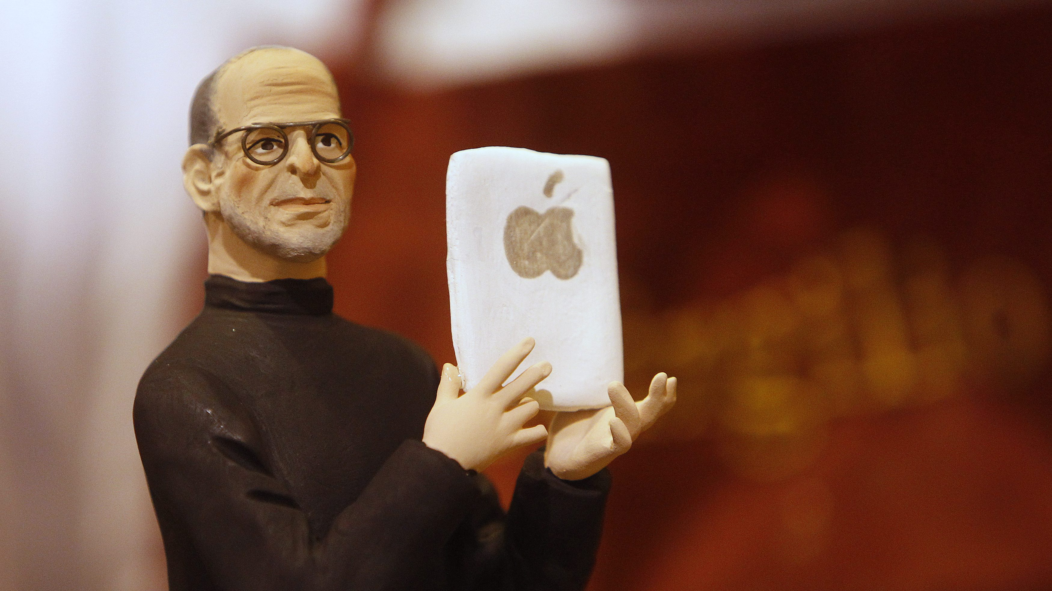 A figure of Apple founder Steve Jobs is seen in an craft shop in Naples